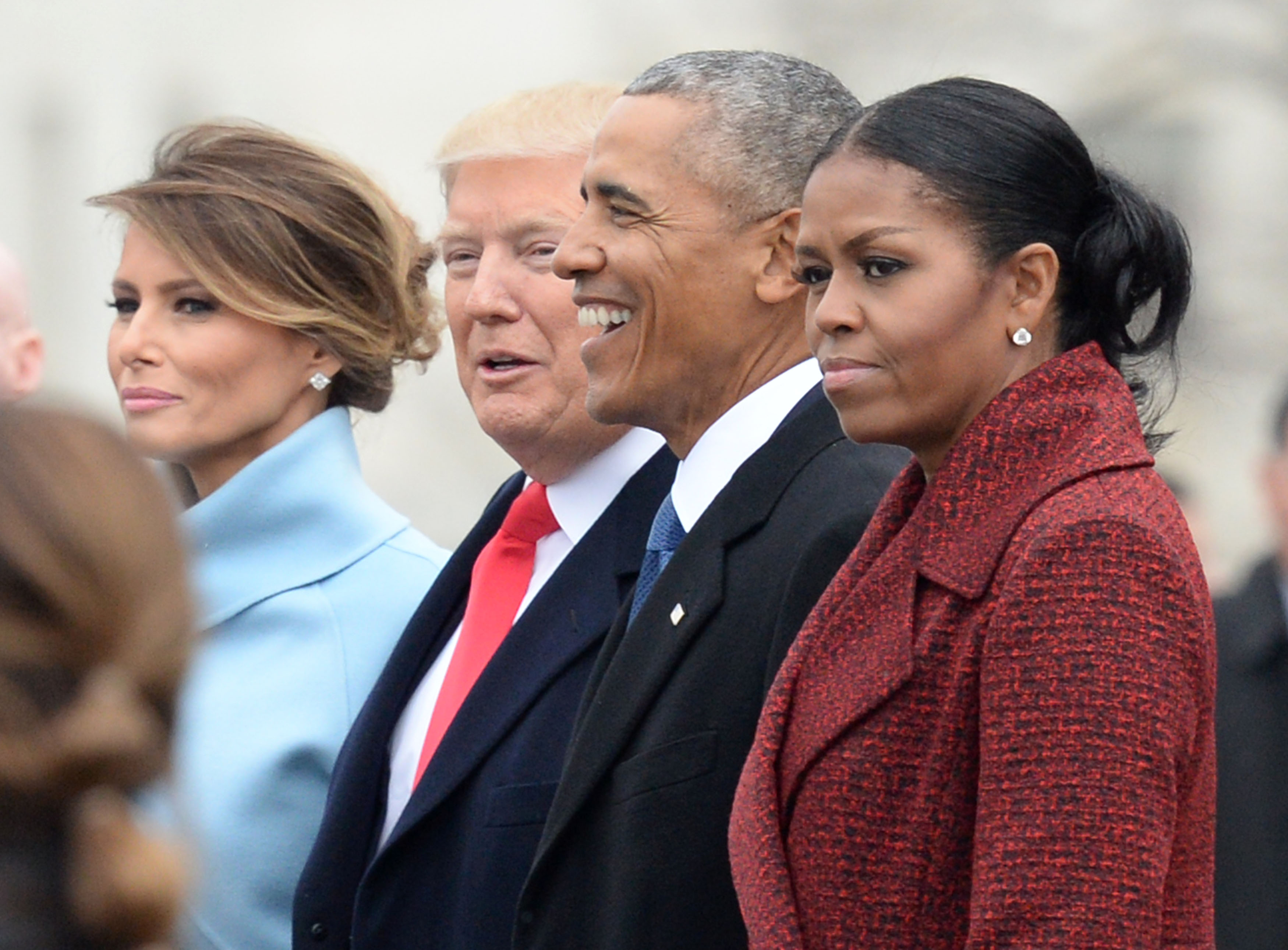 President Donald Trump, First Lady Melania Trump, former President Barack Obama and former First Lady Michelle Obama walk together following the inauguration, on Capitol Hill in Washington, D.C. on January 20, 2017. (Getty Images)