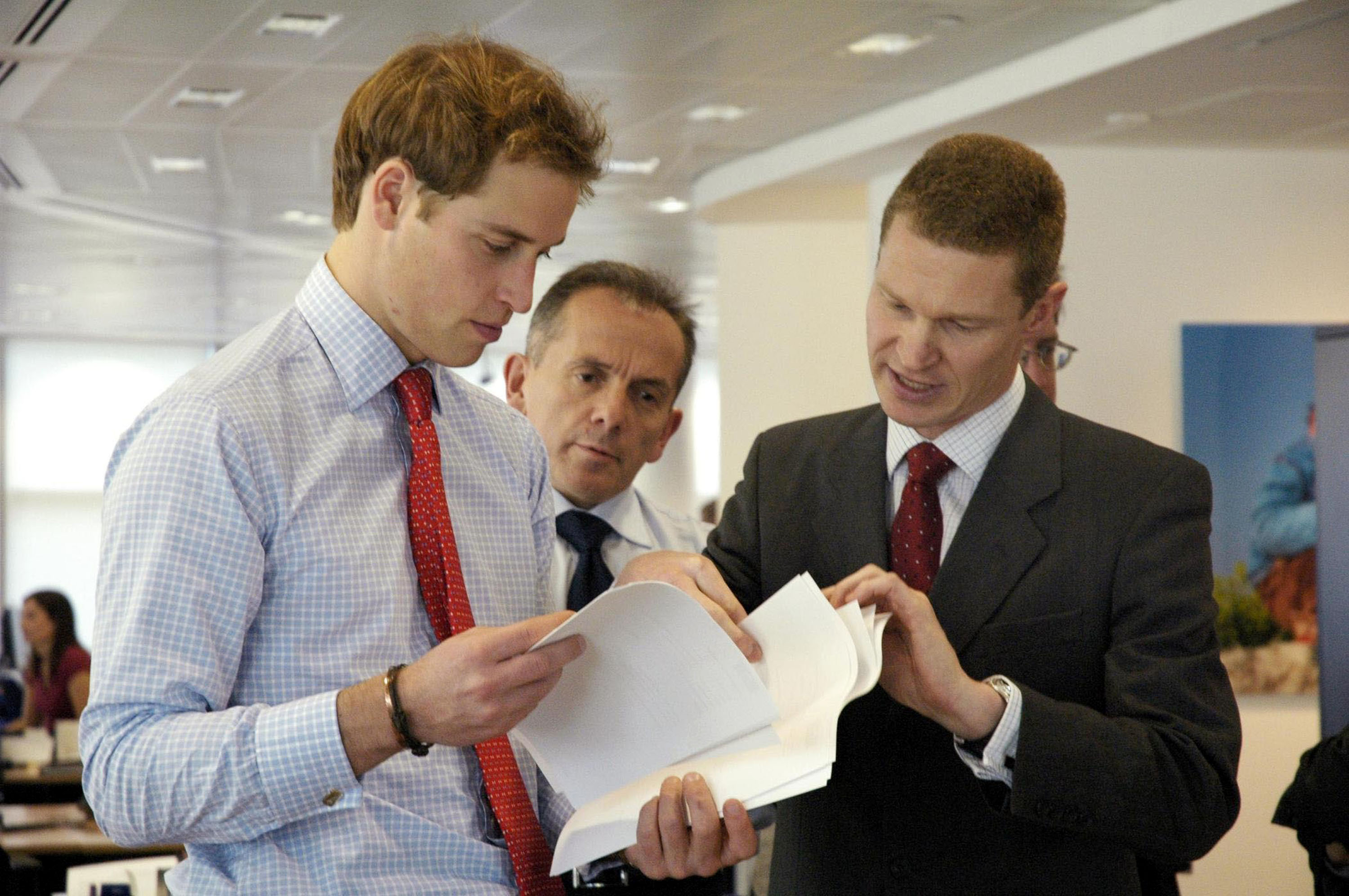 Prince William with Hiscox Plc MD, Steve Langan and James Standen of Aon look at fine art risks at the specialist insurance company's office in London Wednesday November 16 2005. (Photo by Anwar Hussein Collection/ROTA/WireImage)