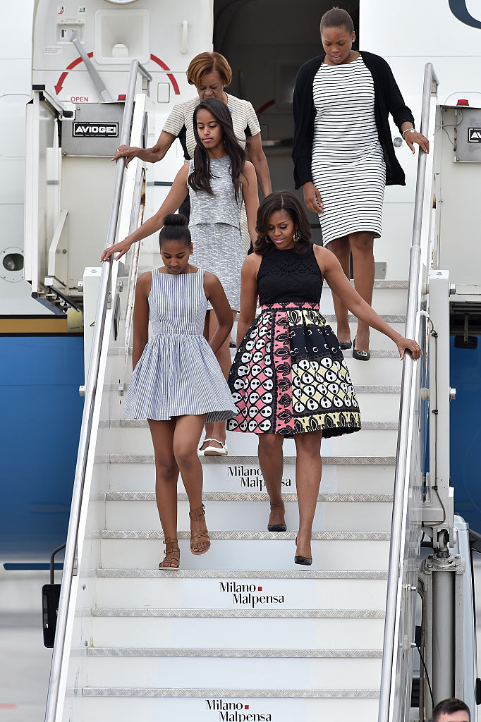 First Lady Michelle Obama arrives with daughters Malia Obama (C) and Sasha Obama (L) and her mother Marian Robinson (behind Malia) at Malpensa Airport on June 17, 2015, in Milan, Italy. (Getty Images)