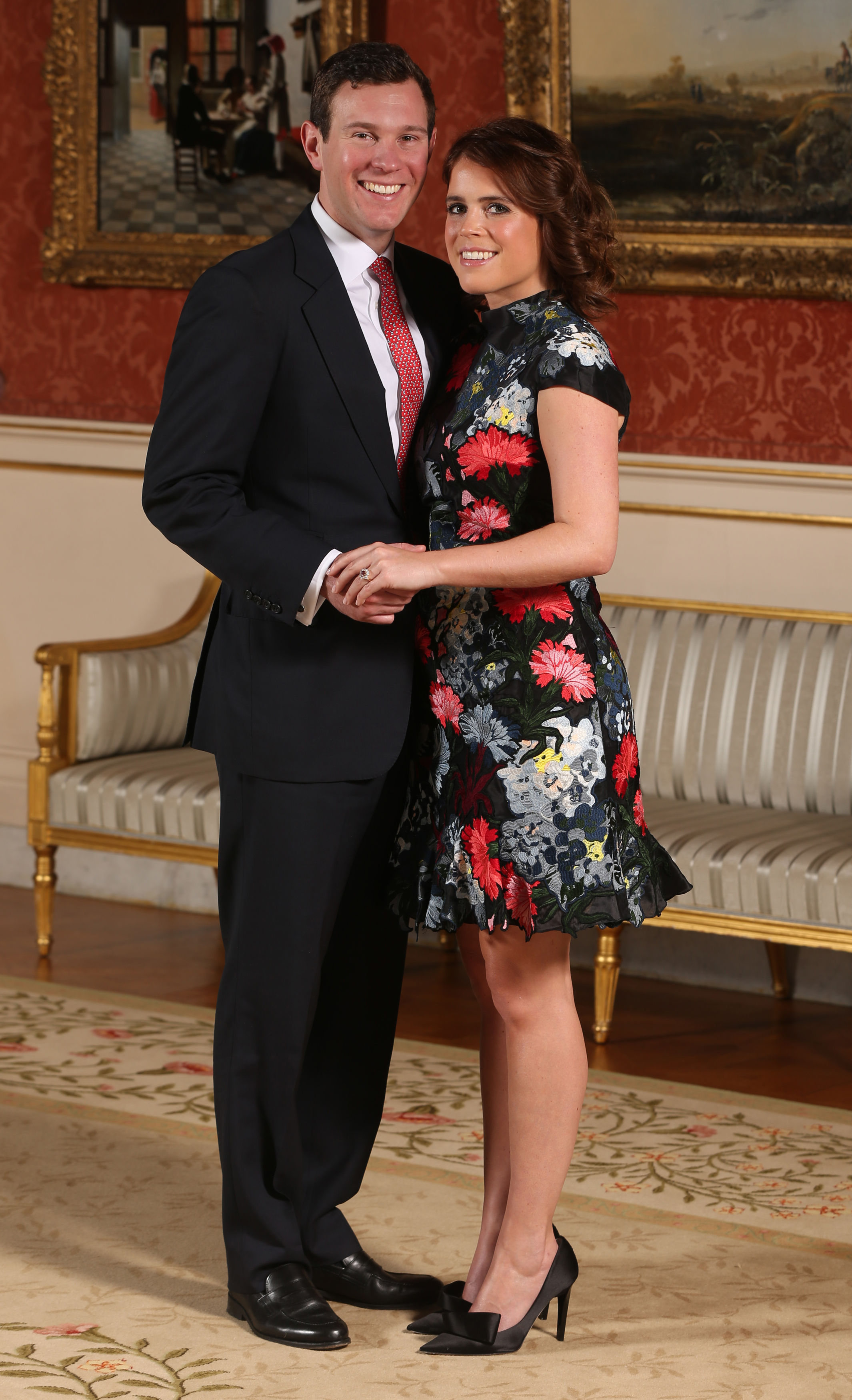 Princess Eugenie and Jack Brooksbank in the Picture Gallery at Buckingham Palace after they announced their engagement. Princess Eugenie wears a dress by Erdem, shoes by Jimmy Choo and a ring containing a padparadscha sapphire surrounded by diamonds on January 22, 2018, in London, England. They are to marry at St George's Chapel in Windsor Castle in the autumn this year. (Getty Images)