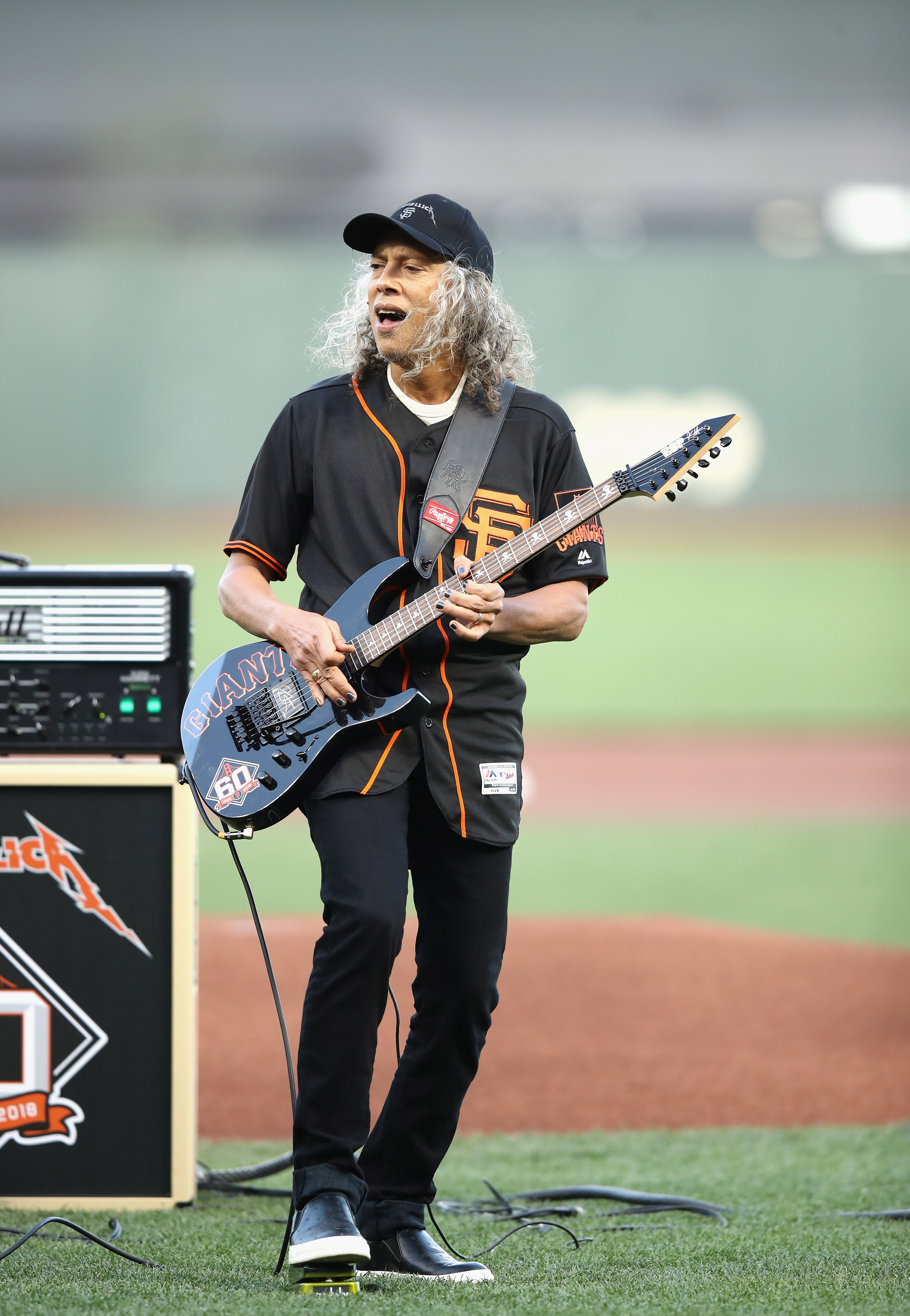 Kirk Hammett with one foot gently planted on his much-used favorite toy - the wah-wah pedal. (Image Source: Getty Images)