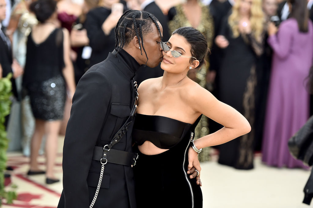 Travis Scott and Kylie Jenner attend the Heavenly Bodies: Fashion & The Catholic Imagination Costume Institute Gala at The Metropolitan Museum of Art on May 7, 2018 in New York City (Photo by Theo Wargo/Getty Images for Huffington Post)
