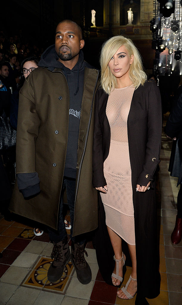 Kanye West and Kim Kardashian attend the Lanvin show as part of the Paris Fashion Week Womenswear Fall/Winter 2015/2016 on March 5, 2015 in Paris, France. (Photo by Pascal Le Segretain/Getty Images)