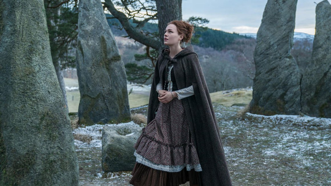 Brianna Fraser (Sophie Skelton) in season 4 of Outlander standing in the fictional place 'Craigh na Dun' (Starz)