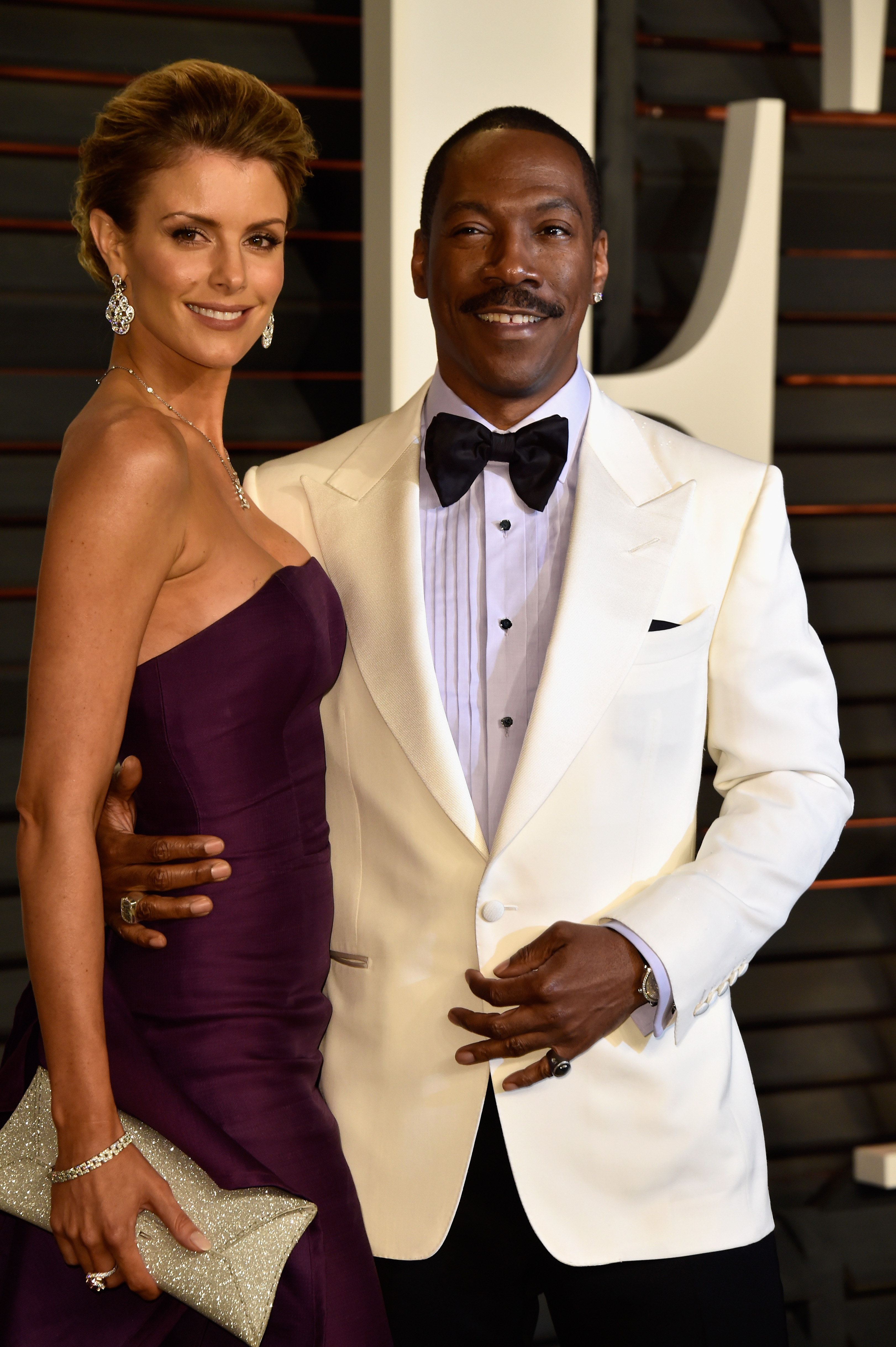 Paige Butcher (L) and actor Eddie Murphy attend the 2015 Vanity Fair Oscar Party hosted by Graydon Carter on February 22, 2015 in Beverly Hills, California. (Photo by Pascal Le Segretain/Getty Images)