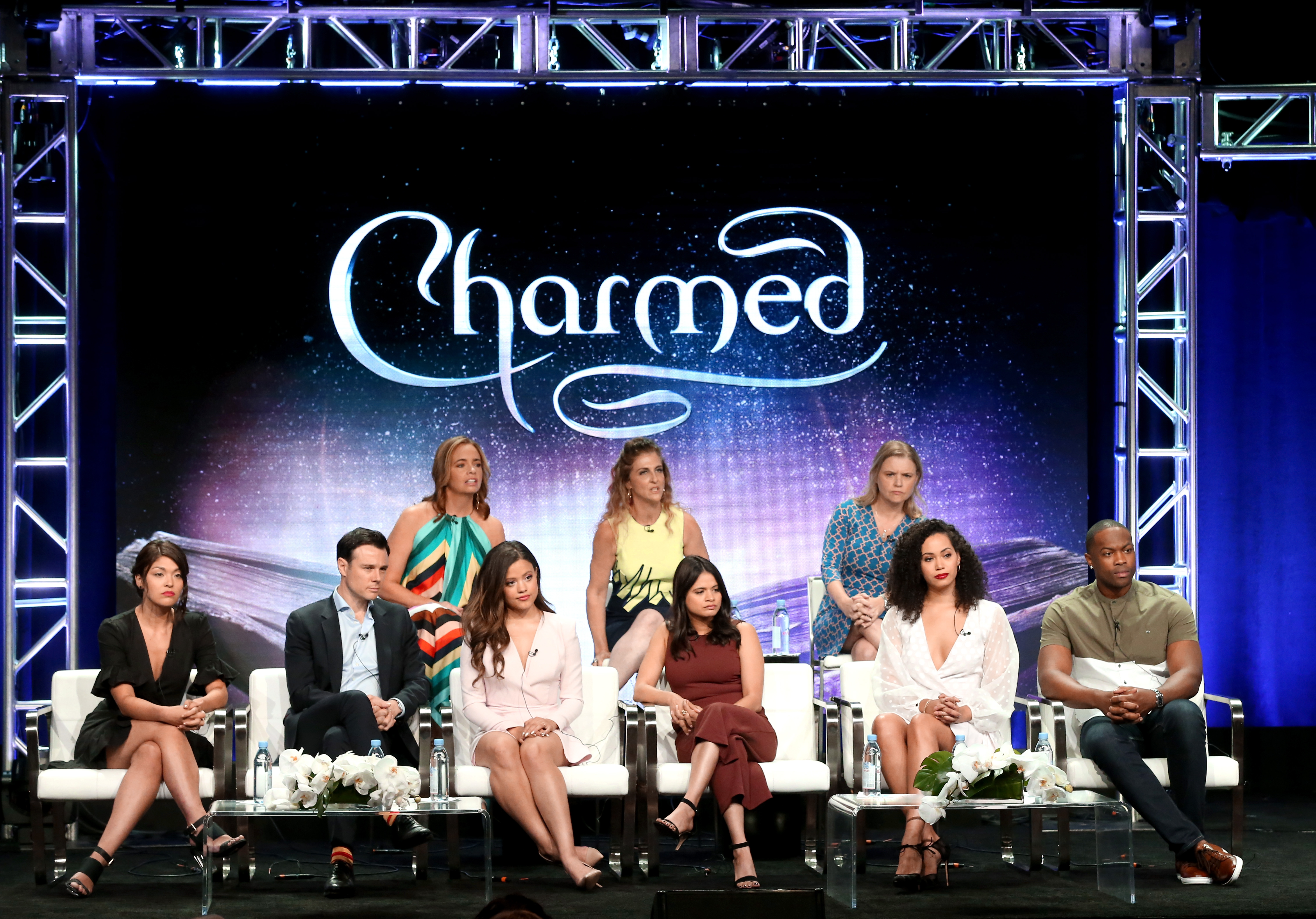 (Top L-R) Jessica O'Toole, Jennie Snyder Urman, Amy Rardin (Bottom L-R) Ellen Tamaki, Rupert Evans, Sarah Jeffery, Melonie Diaz, Madeleine Mantock, and Ser'Darius Blain from 'Charmed' speaks onstage at the CW Network portion of the Summer 2018 TCA Press Tour at The Beverly Hilton Hotel on August 6, 2018 in Beverly Hills, California.
