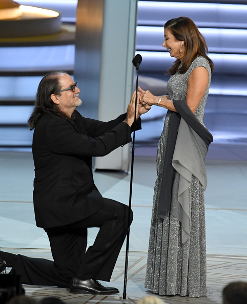 Glenn Weiss (L), winner of the Outstanding Directing for a Variety Special award for 'The Oscars,' proposes marriage to Jan Svendsen onstage during the 70th Emmy Awards at Microsoft Theater on September 17, 2018 in Los Angeles, California. (Photo by Kevin Winter/Getty Images