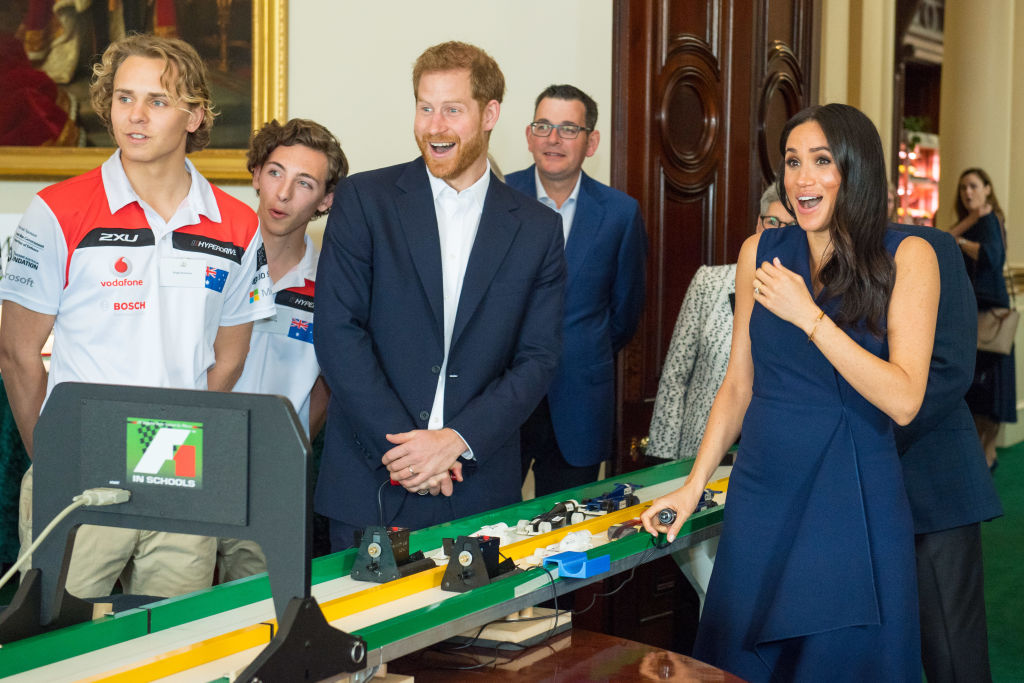 Prince Harry and Meghan start model Formula 1 cars at a demonstration by Formula 1 in Schools, at a reception given by the Governor of Victoria, at Government House on October 18, 2018, in Melbourne, Australia. (Getty Images)
