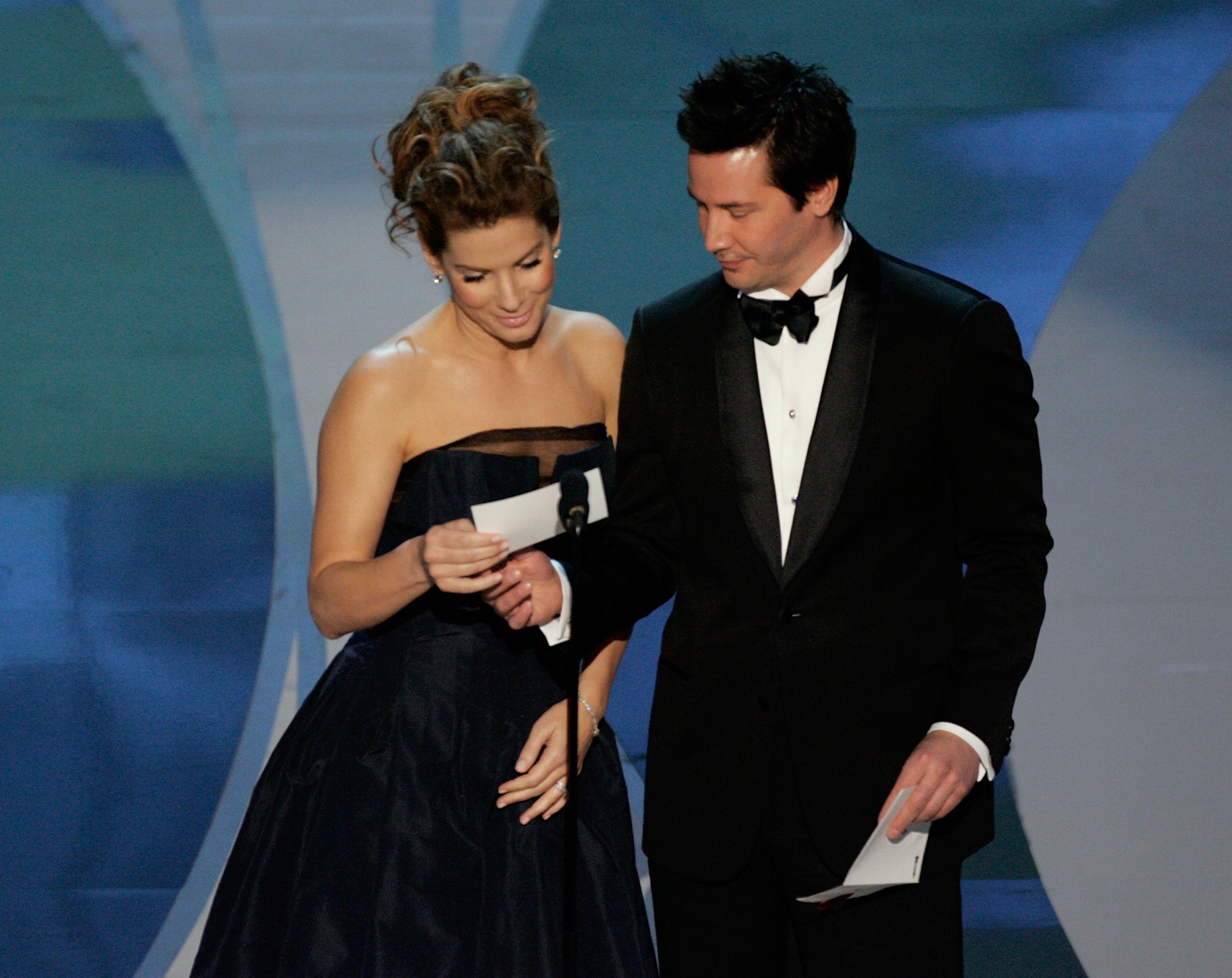 Actors Sandra Bullock and Keanu Reeves present the Achievement in Art Direction on stage during the 78th Annual Academy Awards at the Kodak Theatre on March 5, 2006, in Hollywood, California. (Getty Images)
