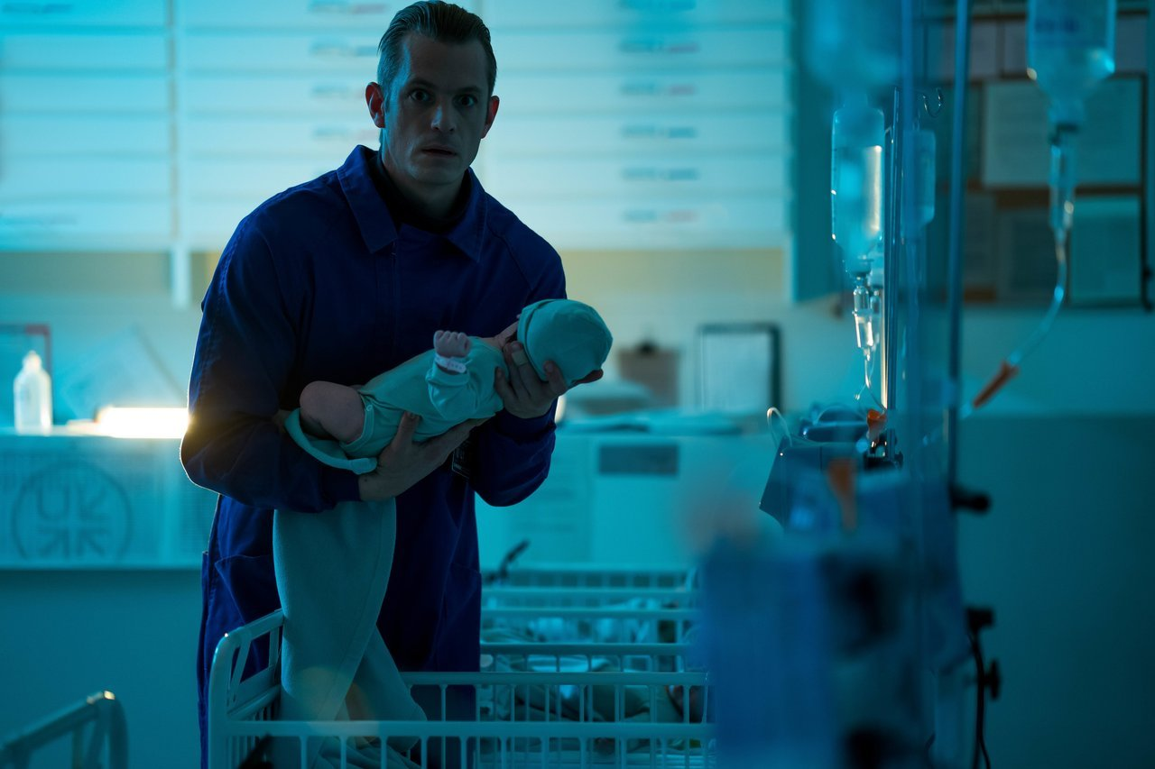 A still of Erik Heller trying to escape with baby Hanna in Amazon's upcoming show. (Source: IMDb)