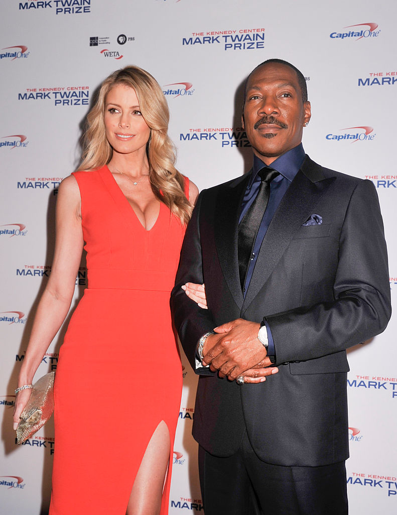 Honoree Eddie Murphy and Paige Butcher pose on the red carpet during the 18th Annual Mark Twain Prize For Humor at The John F. Kennedy Center for Performing Arts on October 18, 2015 in Washington, DC. (Photo by Kris Connor/Getty Images)