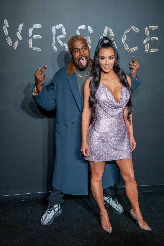 Kanye West and Kim Kardashian West attend the Versace fall 2019 fashion show at the American Stock Exchange Building in lower Manhattan on December 02, 2018, in New York City. (Getty Images)
