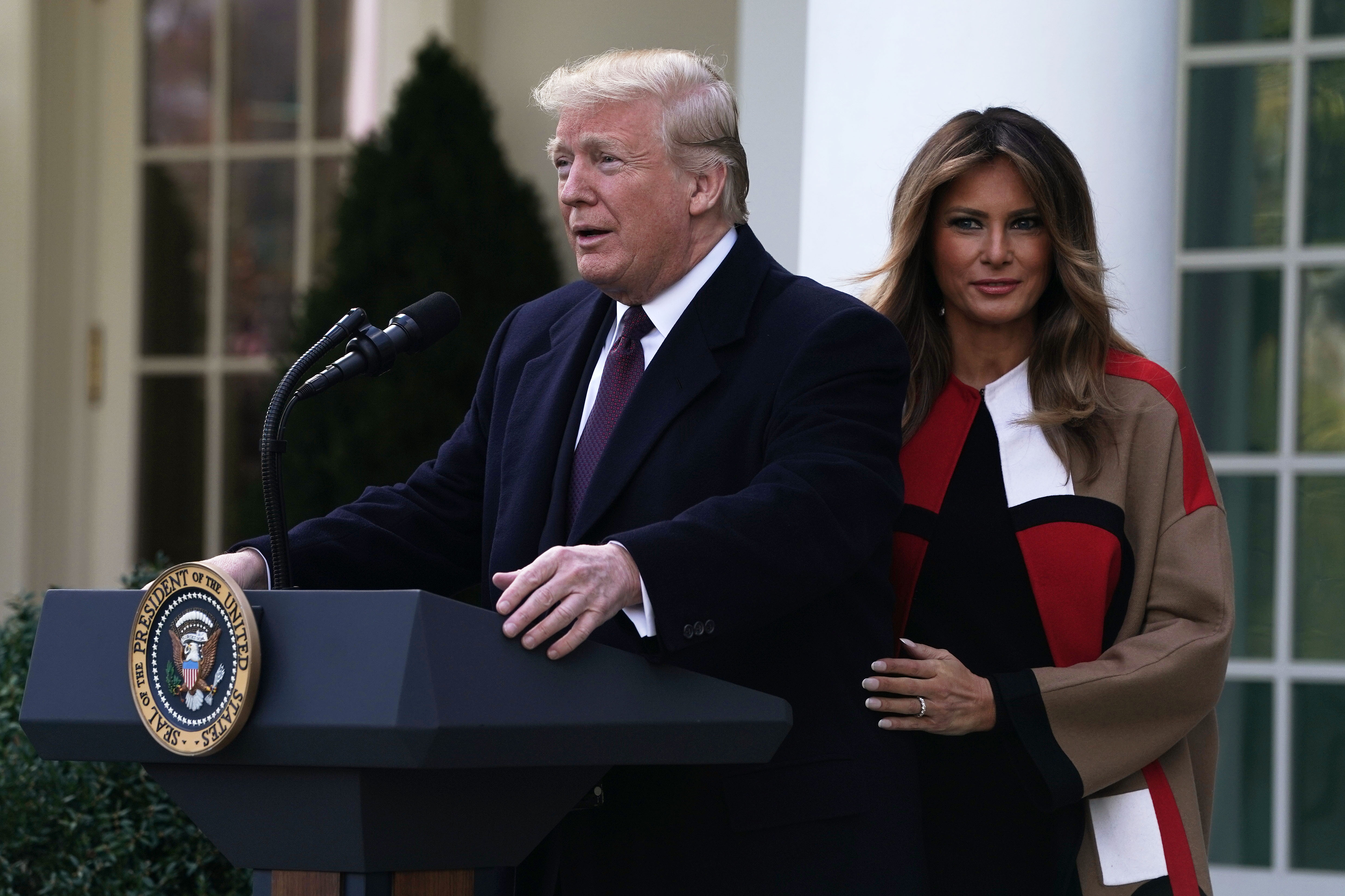 U.S. President Donald Trump (L) and first lady Melania Trump (R) participate in a turkey pardoning event at the Rose Garden of the White House November 20, 2018, in Washington, DC. (Getty)