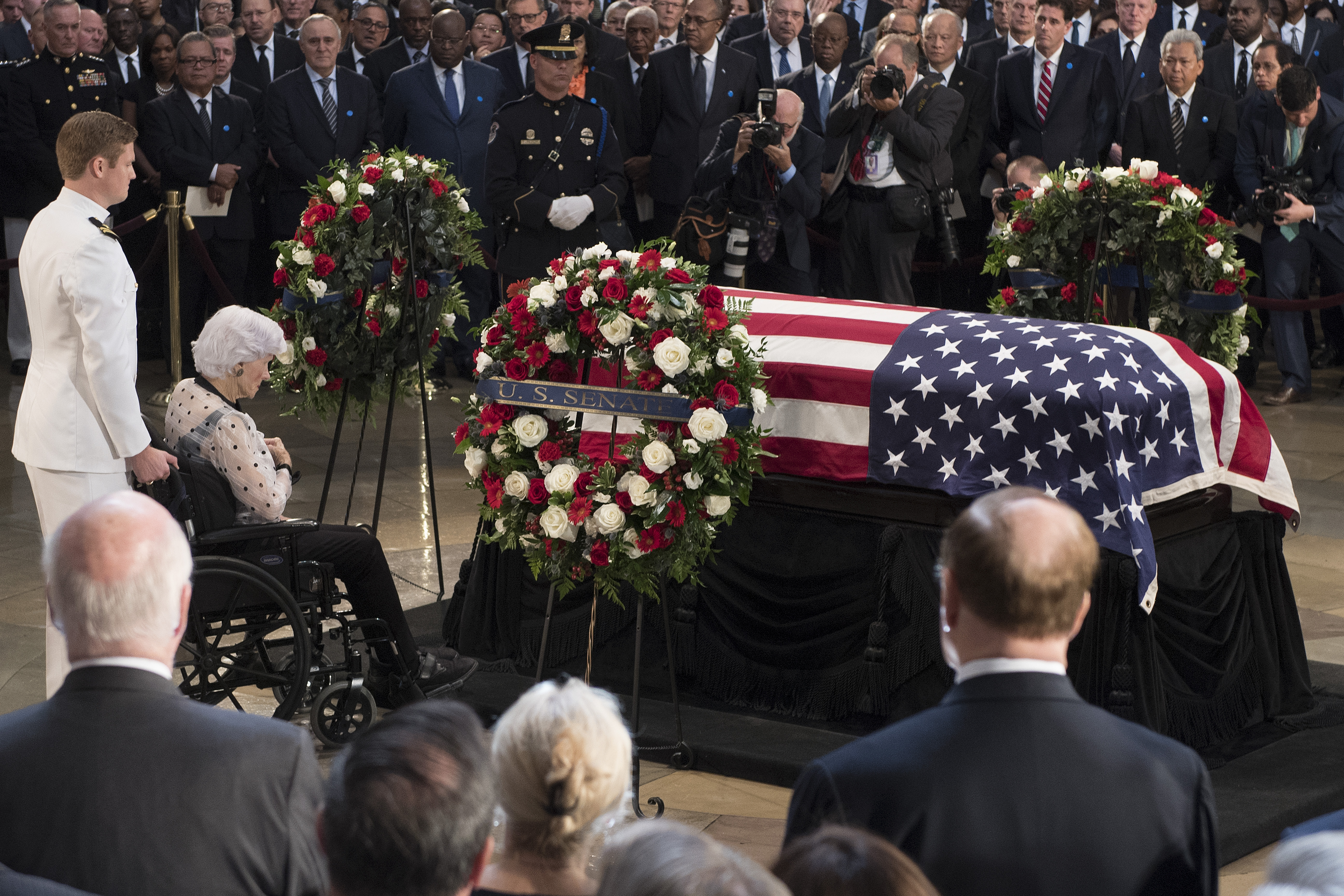Roberta McCain (2nd L), the 106-year-old mother of John McCain, pays her respects to the flag-draped casket bearing the remains of her son, who lived and worked in Congress over four decades, in the U.S. Capitol rotunda for a farewell ceremony and public visitation, on August 31, 2018 in Washington, DC. The late senator died August 25 at the age of 81 after a long battle with brain cancer. He will lie in state at the U.S. Capitol, a rare honor bestowed on only 31 people in the past 166 years. Sen. McCain will be buried at his final resting place at the U.S. Naval Academy.