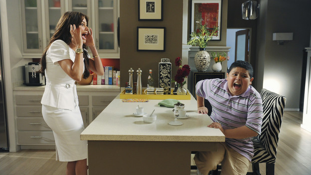 A scene from Modern Family with Sofia Vergara and Rico Rodriguez on Gloria's kitchen set