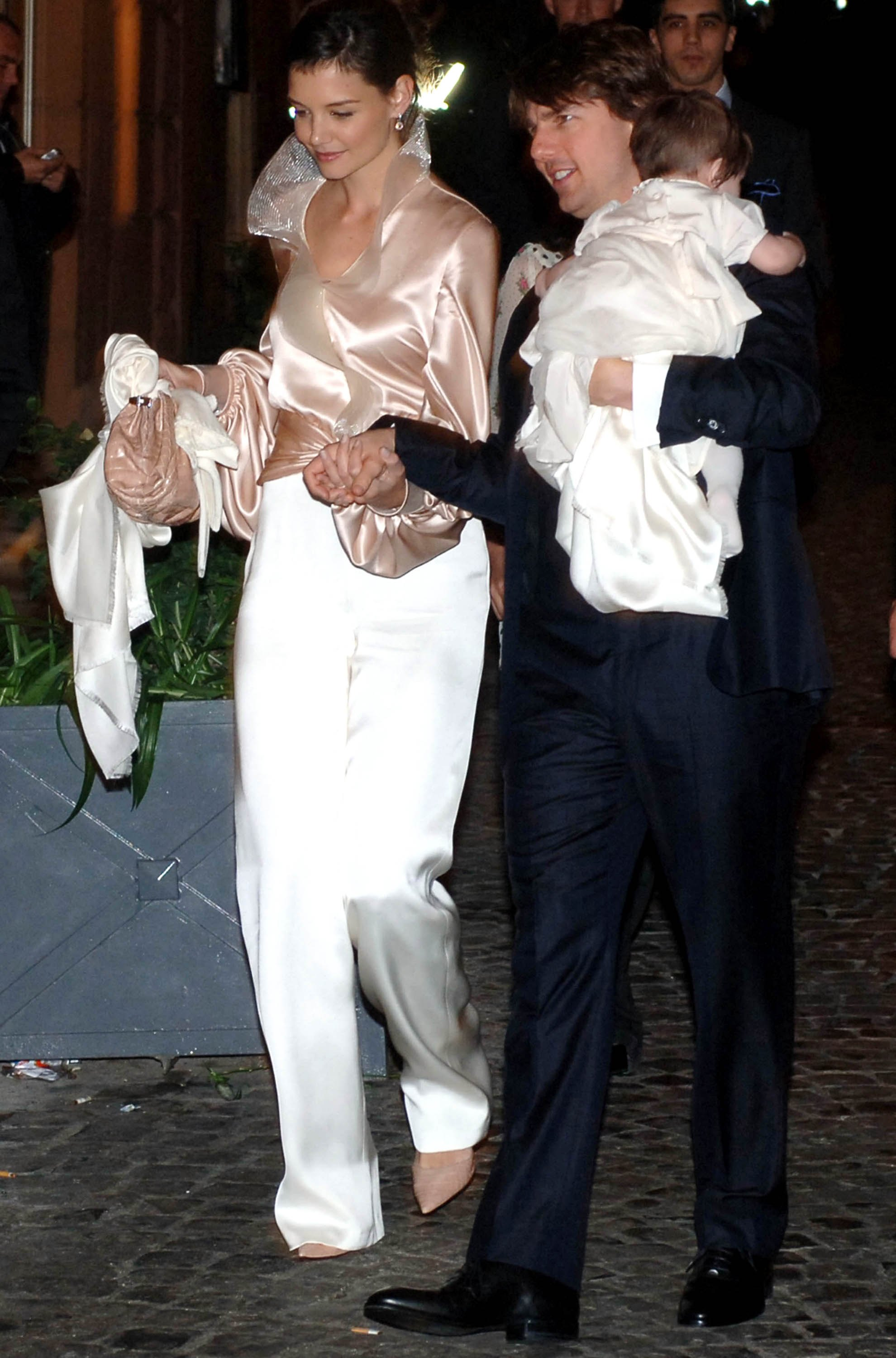 Tom Cruise, Katie Holmes and their daughter Suri arrives in a restaurant in central Rome on November 16, 2006 in Rome, Italy.