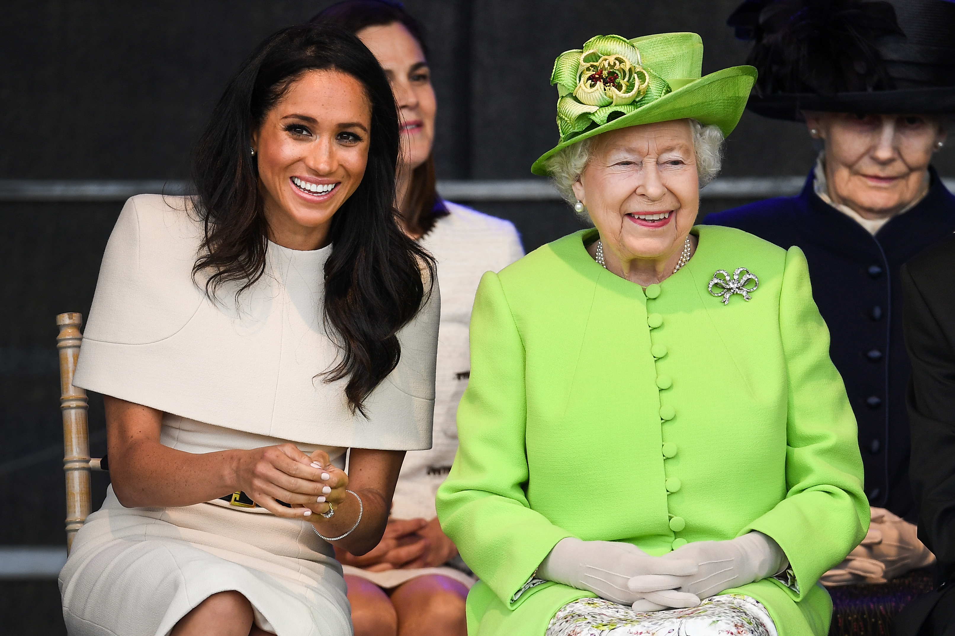 Queen Elizabeth II sits with Meghan, Duchess of Sussex during a ceremony to open the new Mersey Gateway Bridge on June 14, 2018 in the town of Widnes in Halton, Cheshire, England. Meghan Markle married Prince Harry last month to become The Duchess of Sussex and this is her first engagement with the Queen. During the visit the pair will open a road bridge in Widnes and visit The Storyhouse and Town Hall in Chester.