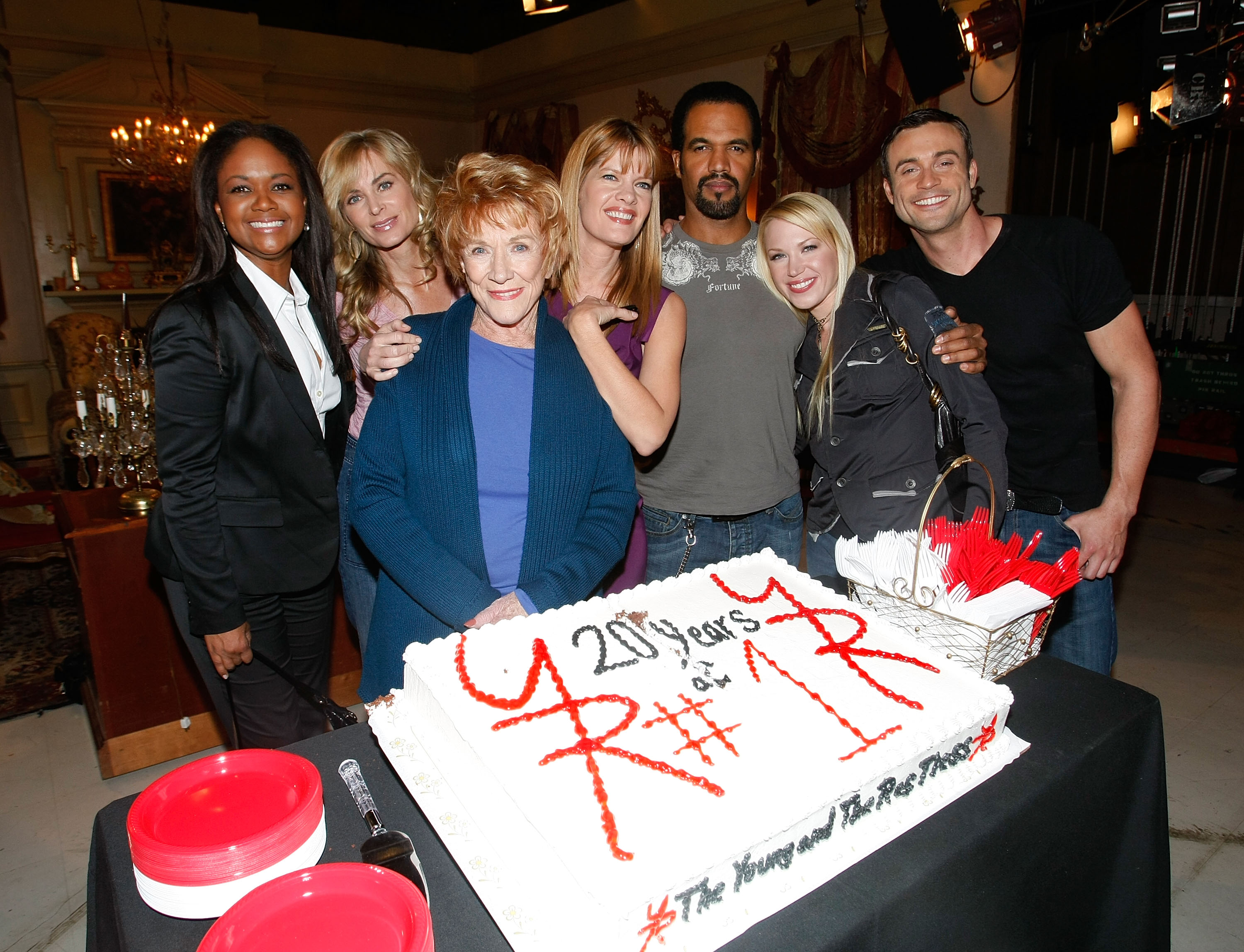(L-R) Cast members of 'The Young and the Restless' actors Tonya Lee Williams, Eileen Davidson, Jeanne Cooper, Michelle Stafford, Kristoff St. John, Adrienne Frantz and Daniel Godbard attend the cake cutting ceremony celebrating 'The Young and the Restless' staying the number one rated daytime drama series for twenty years straight at CBS Studios on December 11, 2008 in Los Angeles, California. (Getty)