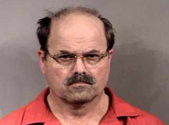 BTK killer Dennis Rader stands for a mug shot released February 27, 2005, in Sedgwick County, Kansas (Source: Sedgwick County Sheriff's Office via Getty Images)