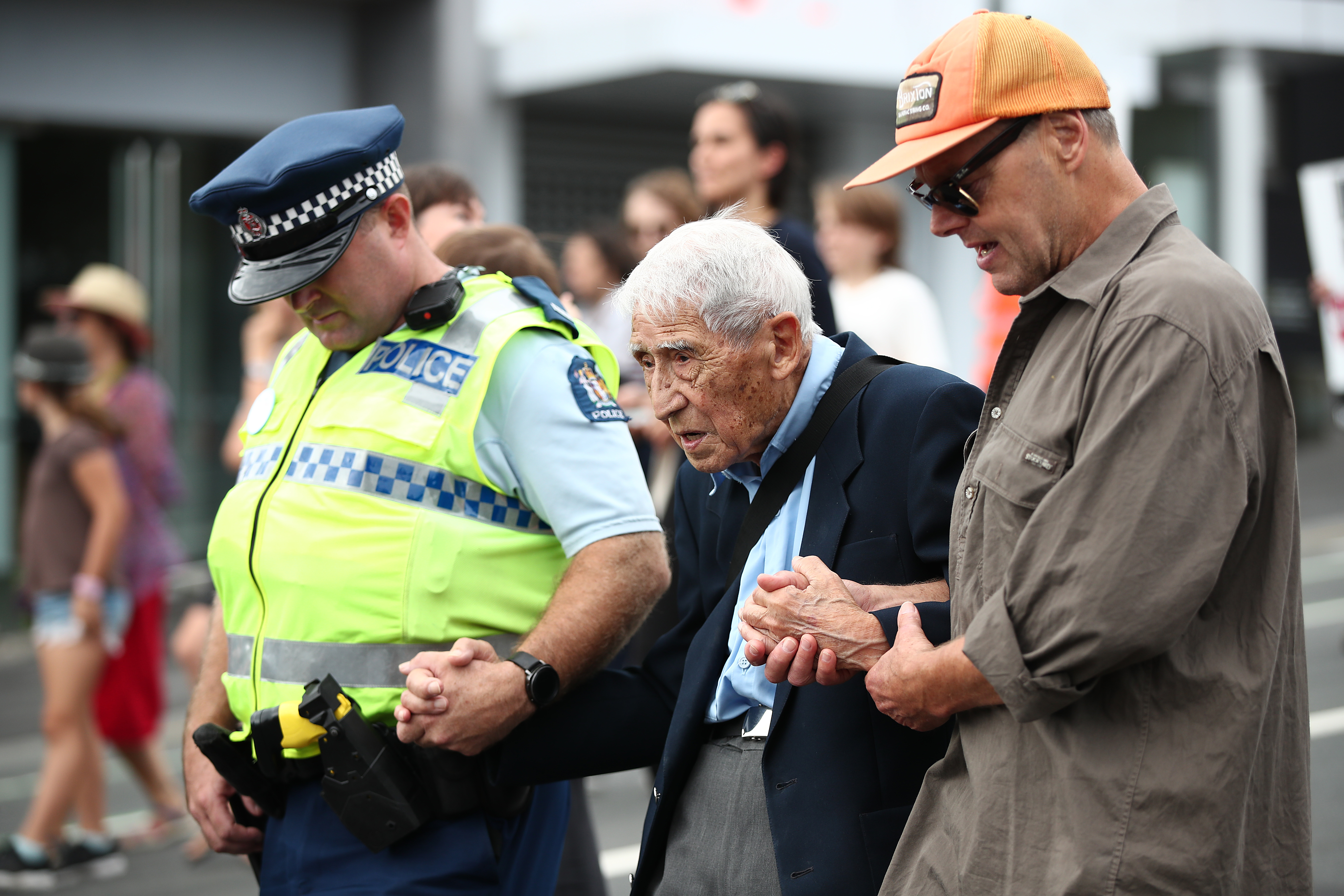 John Sato (C) 95, one of only two Japaenses servicemen in the New Zealand army in WWII, took two buses from Howick to join the march against racism at Aotea Square on March 24, 2019 in Auckland, New Zealand. (Getty Images)