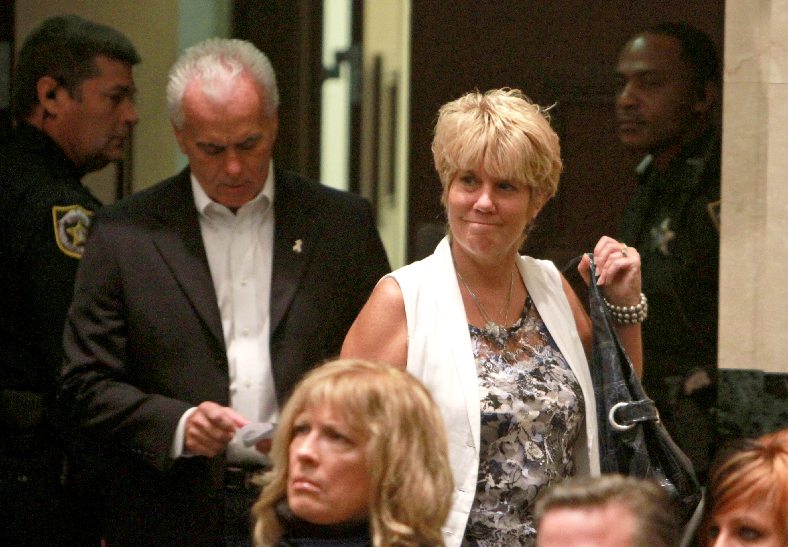 George (2nd L) and Cindy Anthony (2nd R) enter the courtroom of their daughter, Casey Anthony's sentencing on charges of lying to a law enforcement officer at the Orange County Courthouse July 7, 2011 in Orlando, Florida.
