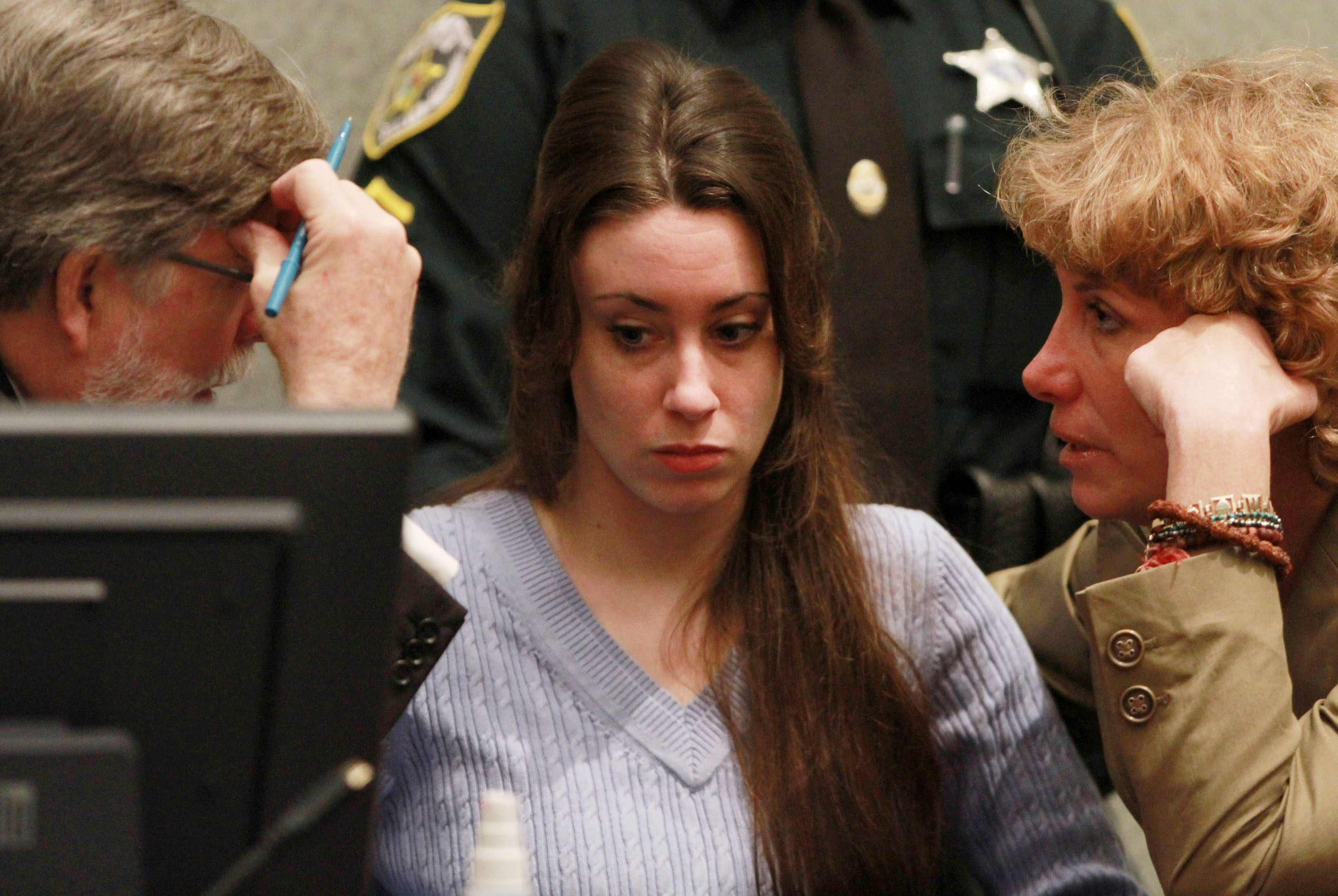 Casey Anthony (C) sits with her attorneys Cheney Mason (L) and Dorothy Clay Sims (R) before the start of her sentencing hearing on charges of lying to a law enforcement officer at the Orange County Courthouse July 7, 2011 in Orlando, Florida. Anthony was acquitted of murder charges on July 5, 2011 but will serve four, one-year sentences on her conviction of lying to a law enforcement officer. She will be credited for the nearly three-years of time served and good behavior and will be released July 13.