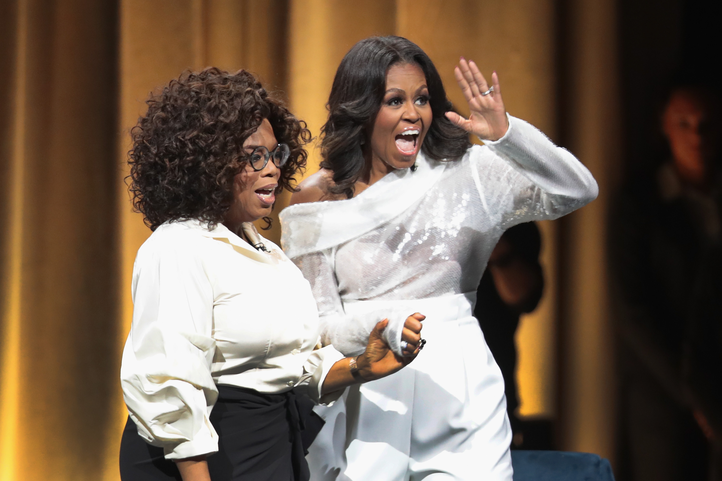 Oprah Winfrey introduces former first lady Michelle Obama as she kicks off her 'Becoming' arena book tour on November 13, 2018 in Chicago, Illinois. In the book, which was released today, Obama describes her journey from Chicago's South Side to the White House.