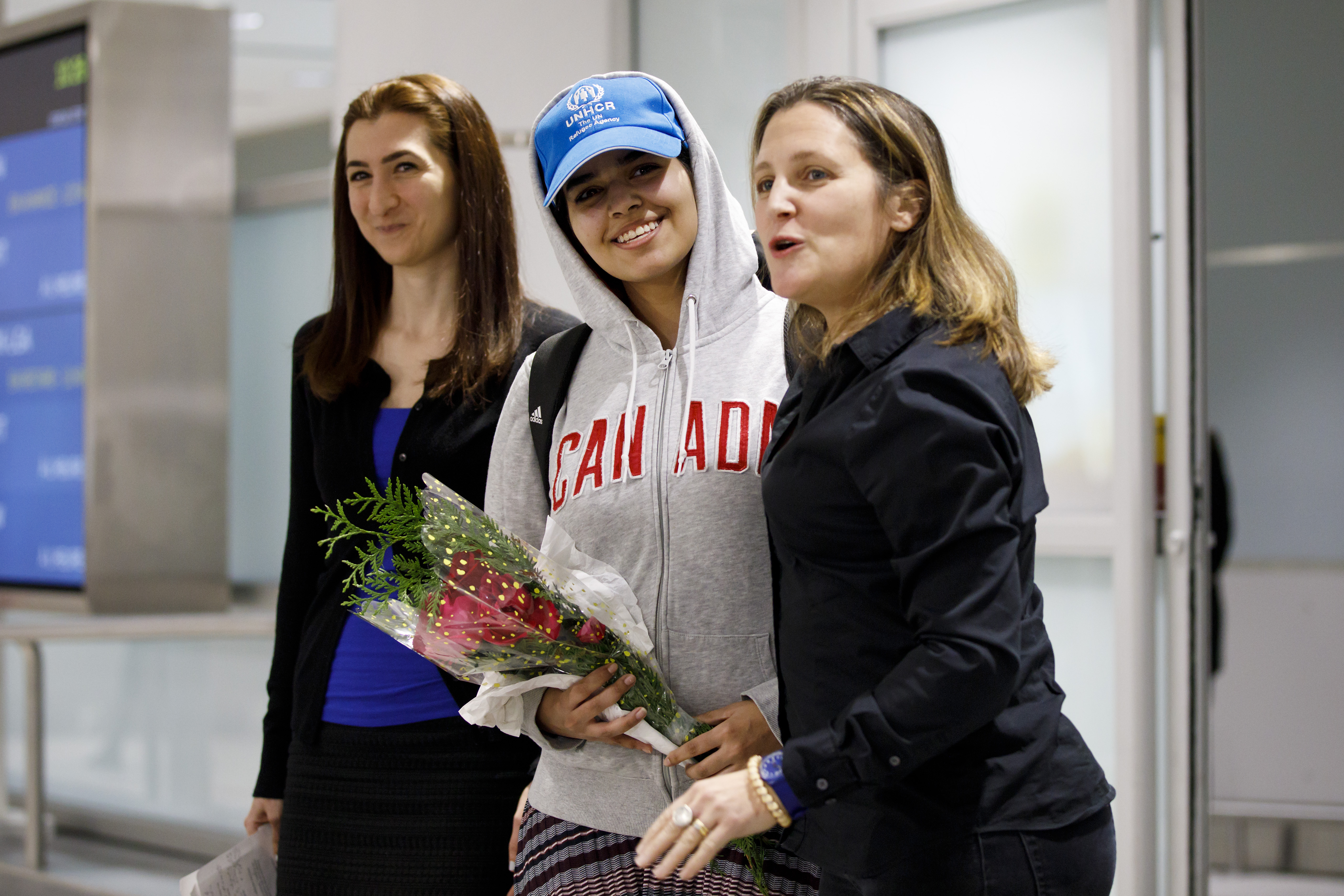 Asylum Seeker Rahaf Mohammed al-Qunun, 18, smiles as she is introduced to the media at Toronto Pearson International Airport, alongside Canadian minister of Foreign Affairs Chrystia Freeland, right, on January 12, 2019 in Toronto, Canada. (Getty Images)