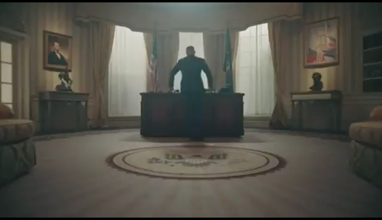 T.I. can be seen standing in the video in a room similar to the Oval Office.