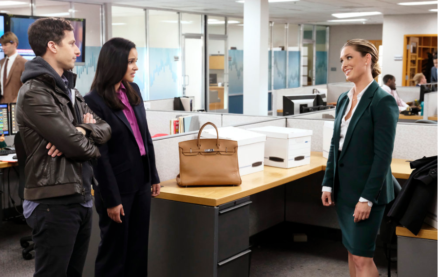 (L-R) Andy Samberg as Jake Peralta, Melissa Fumero as Amy Santiago, Briga Heelan as Keri Brennan. (Source: Trae Patton/NBC)