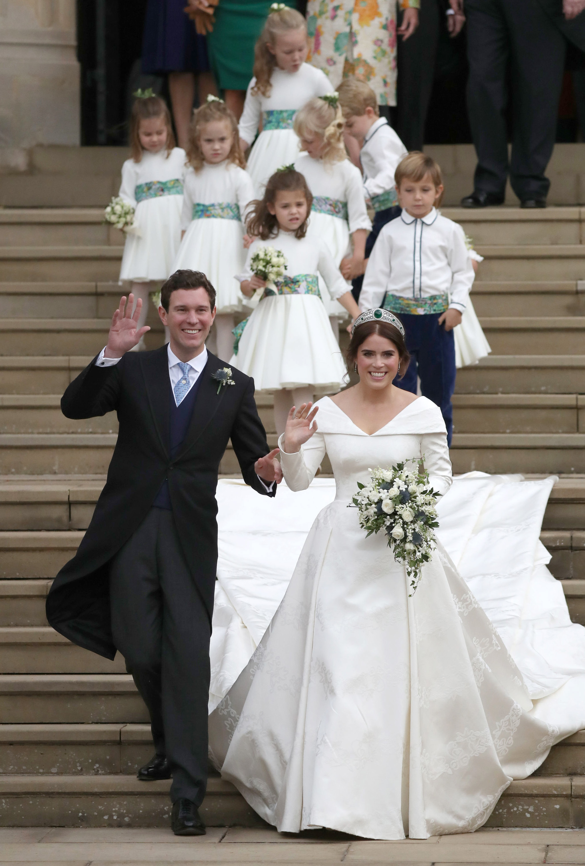 Jack Brooksbank and Princess Eugenie of York walk down the steps followed by their page boys and bridesmaids after their wedding ceremony at St. George's Chapel on October 12, 2018, in Windsor, England. (Getty Images)