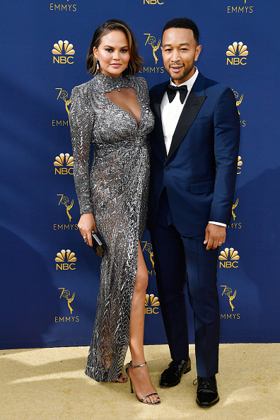 Chrissy Teigen (L) and John Legend attend the 70th Emmy Awards at Microsoft Theater on September 17, 2018 in Los Angeles, California. (Photo by Frazer Harrison/Getty Images)