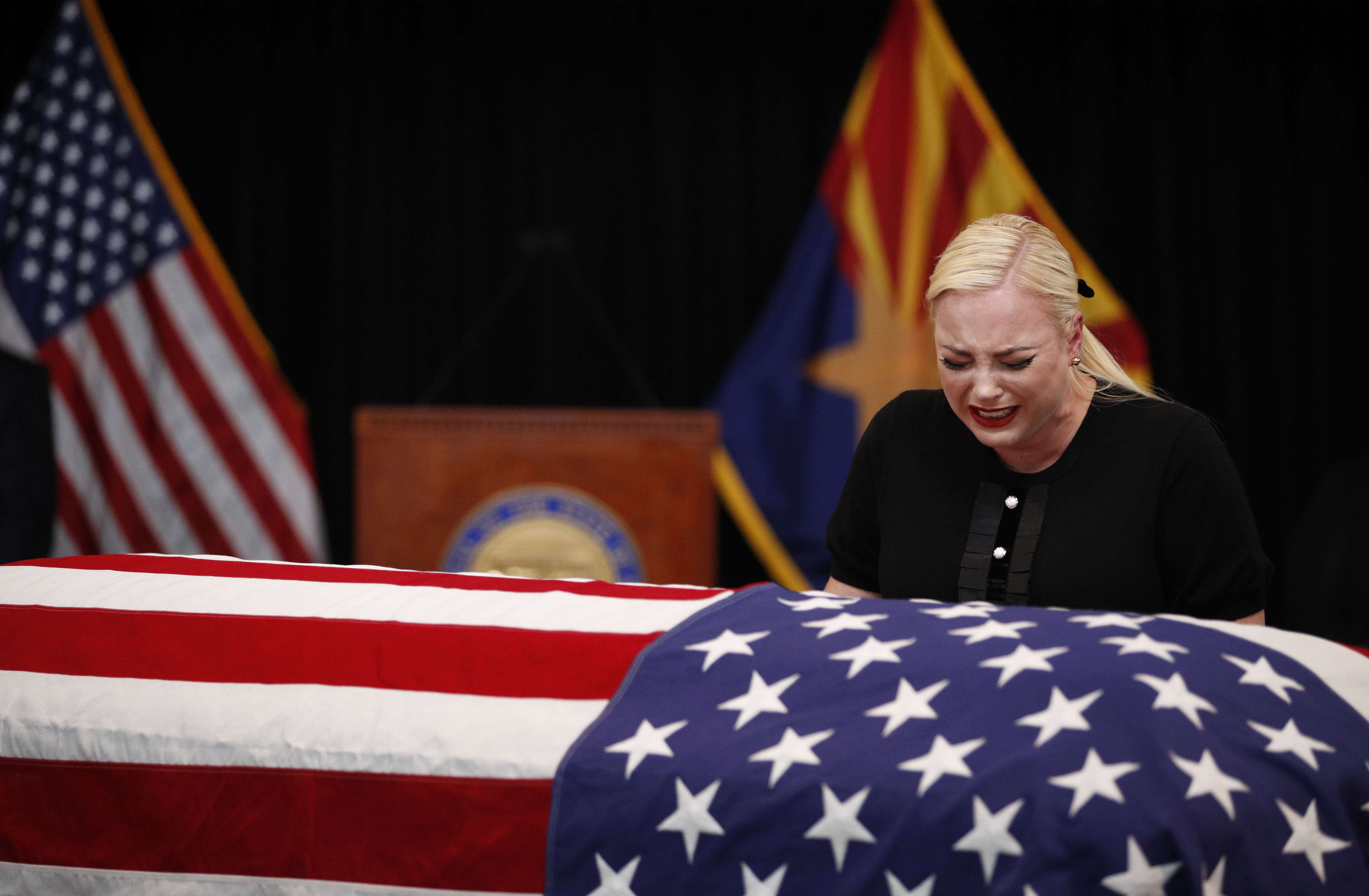 Meghan McCain, daughter of Sen. John McCain, touches the casket during a memorial service at the Arizona Capitol on August 29, 2018, in Phoenix, Arizona. John McCain will lie in state at the Arizona State Capitol before being transported to Washington D.C. where he will be buried at the U.S. Naval Academy Cemetery in Annapolis. Sen. McCain, a decorated war hero, died August 25 at the age of 81 after a long battle with Glioblastoma, a form of brain cancer. (Getty Images)