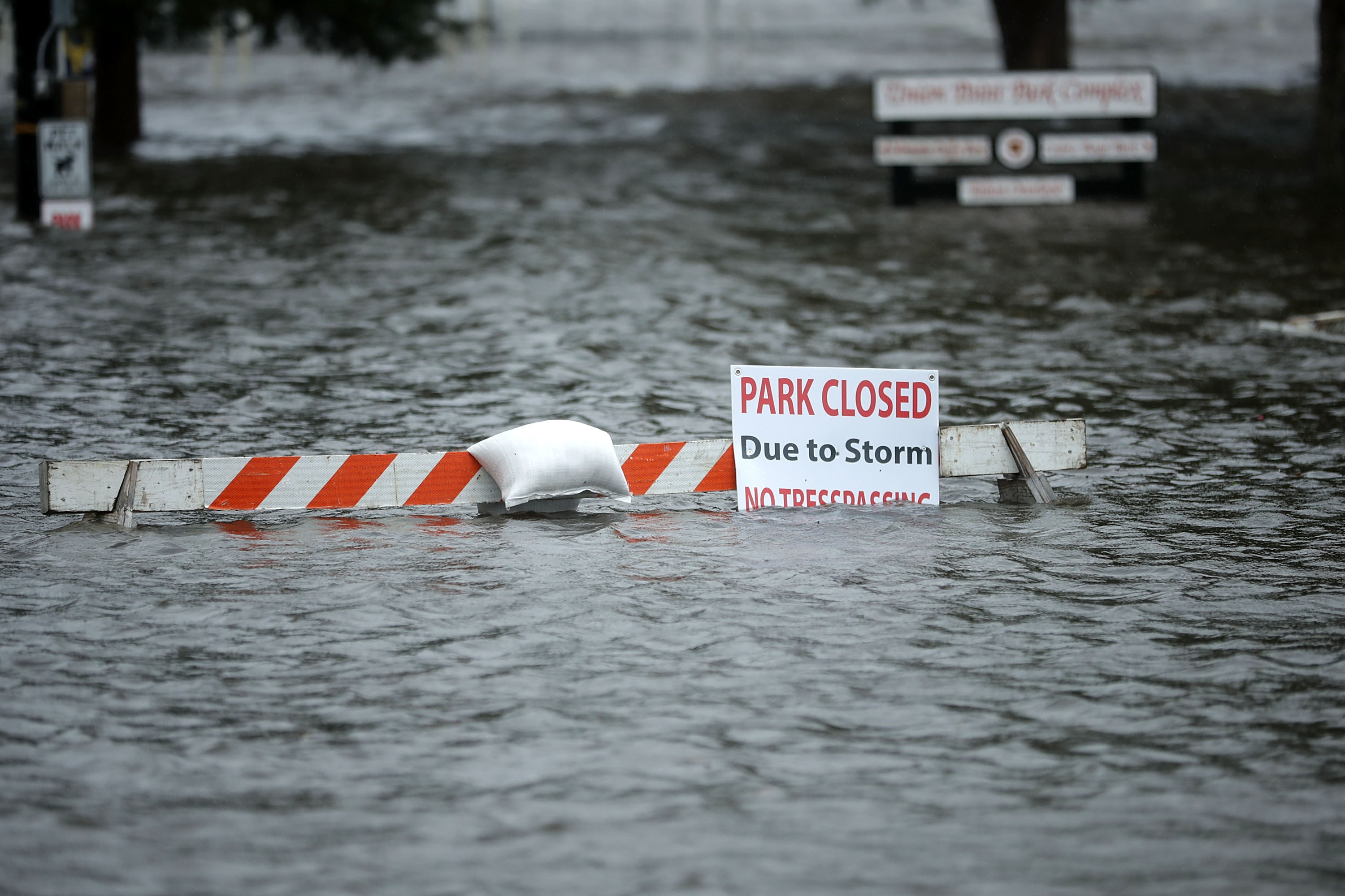 A sign warns people away from Union Point Park after is was flooded by the Neuse River during Hurricane Florence September 13, 2018 in New Bern, North Carolina. Coastal cities in North Carolina, South Carolina and Virginia are under evacuation orders as the Category 2 hurricane approaches the United States.