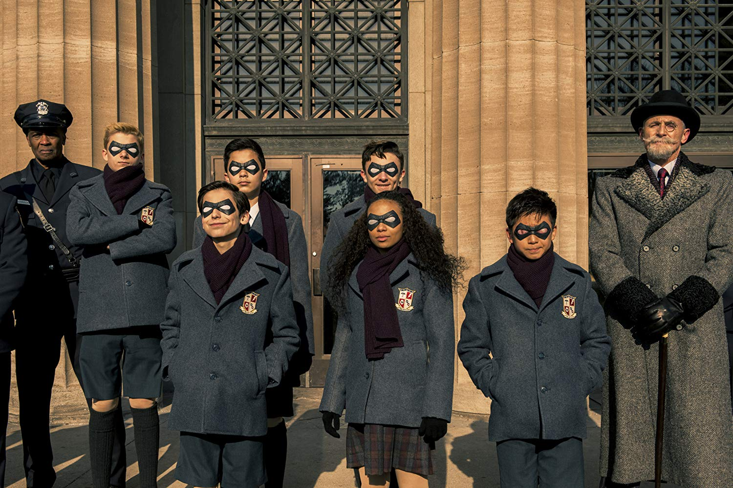 Colm Feore, Dante Albidone, Aidan Gallagher, Cameron Brodeur, Eden Cupid, Ethan Hwang, and Blake Talabis in 'The Umbrella Academy'. (Source: IMDB)