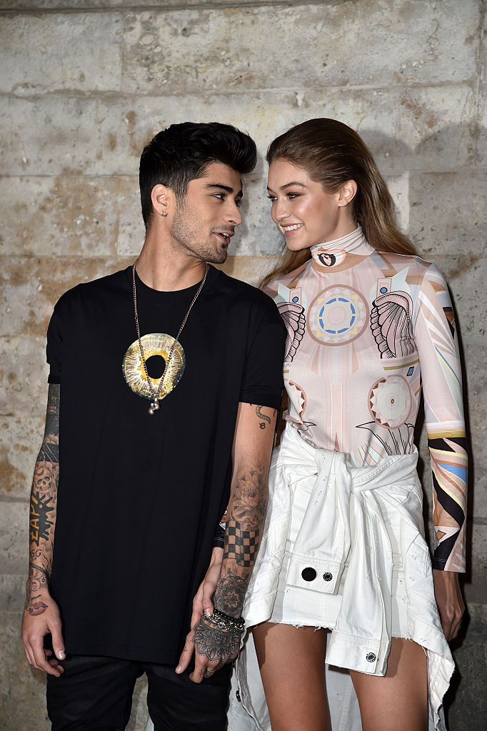 Zayn Malik and Gigi Hadid attend the Givenchy show as part of the Paris Fashion Week Womenswear Spring/Summer 2017 on October 2, 2016, in Paris, France. (Getty Images)