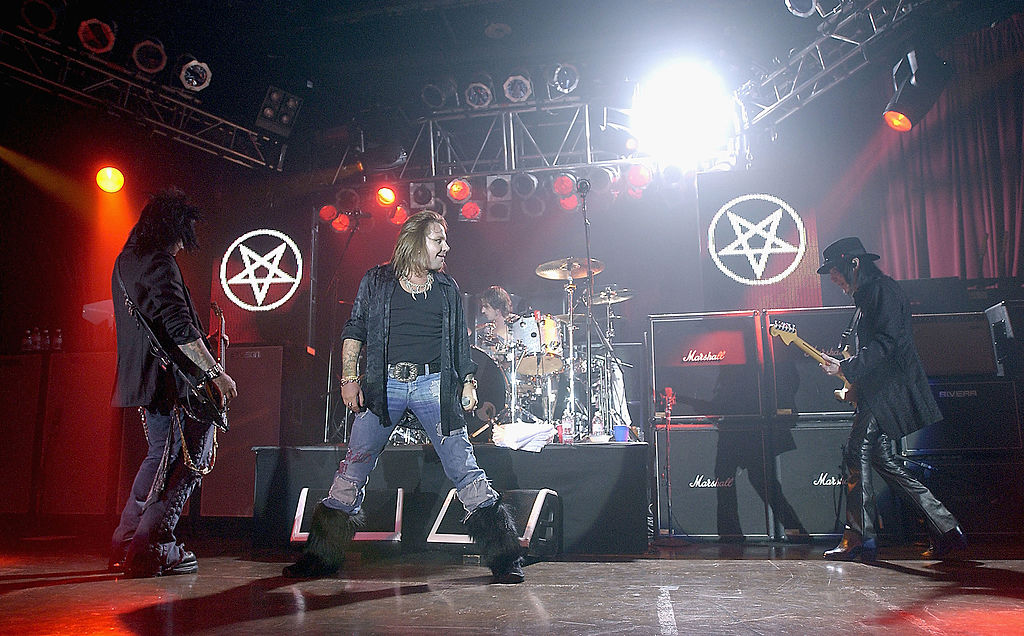 All four original members of Motely Crue reunite after six years to announce 'Red, White & Crue Tour 2005...Better Live than Dead' at the Hollywood Palladium on December 6, 2004, in Los Angeles, California. (Source: Amanda Edwards/Getty Images)