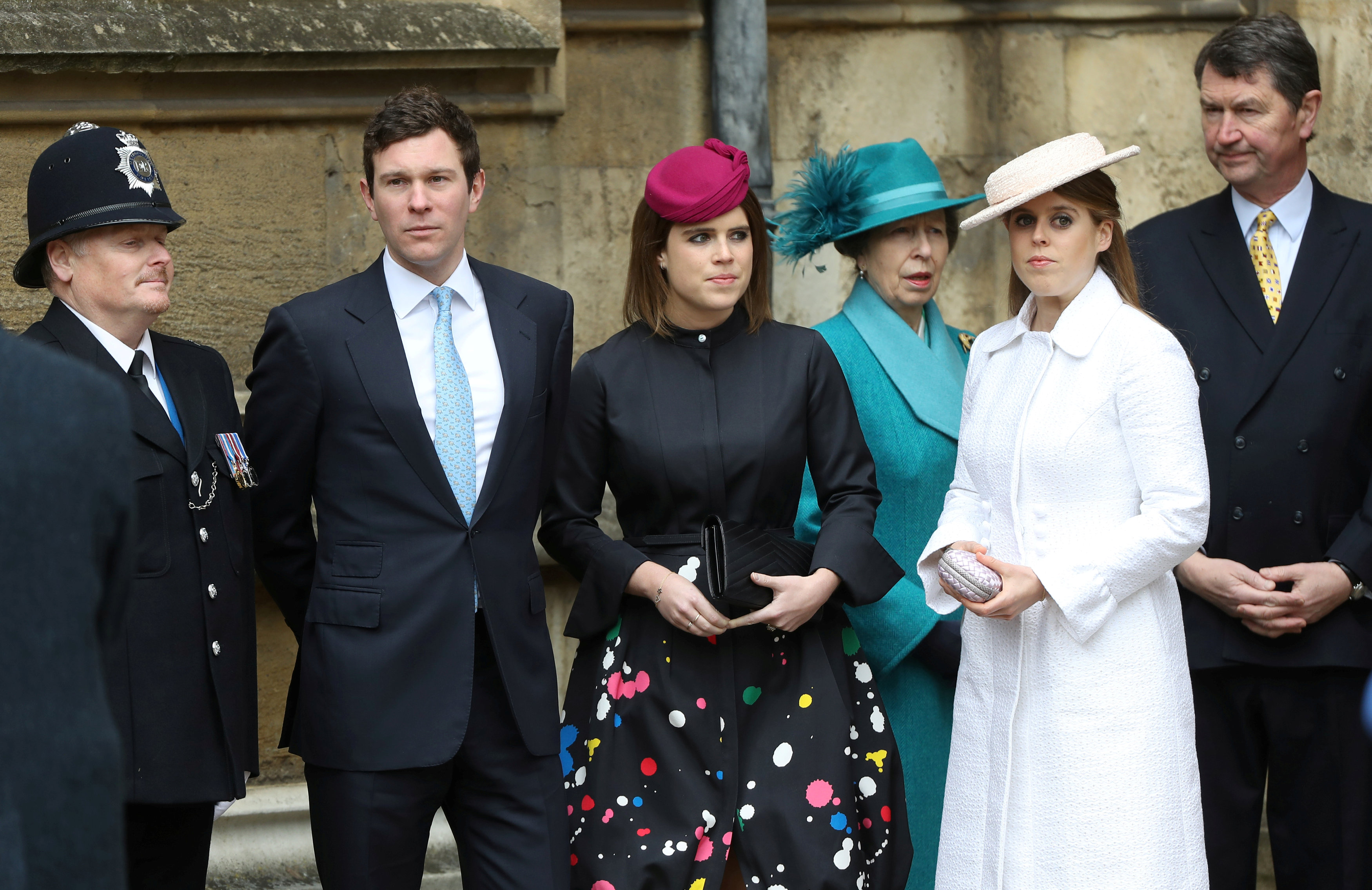 Jack Brooksbank, Princess Eugenie, Princess Anne, Princess Royal, Princess Beatrice and Vice Admiral Sir Timothy Laurence arrive for the Easter Mattins Service at St. George's Chapel at Windsor Castle on April 1, 2018 in Windsor, England.