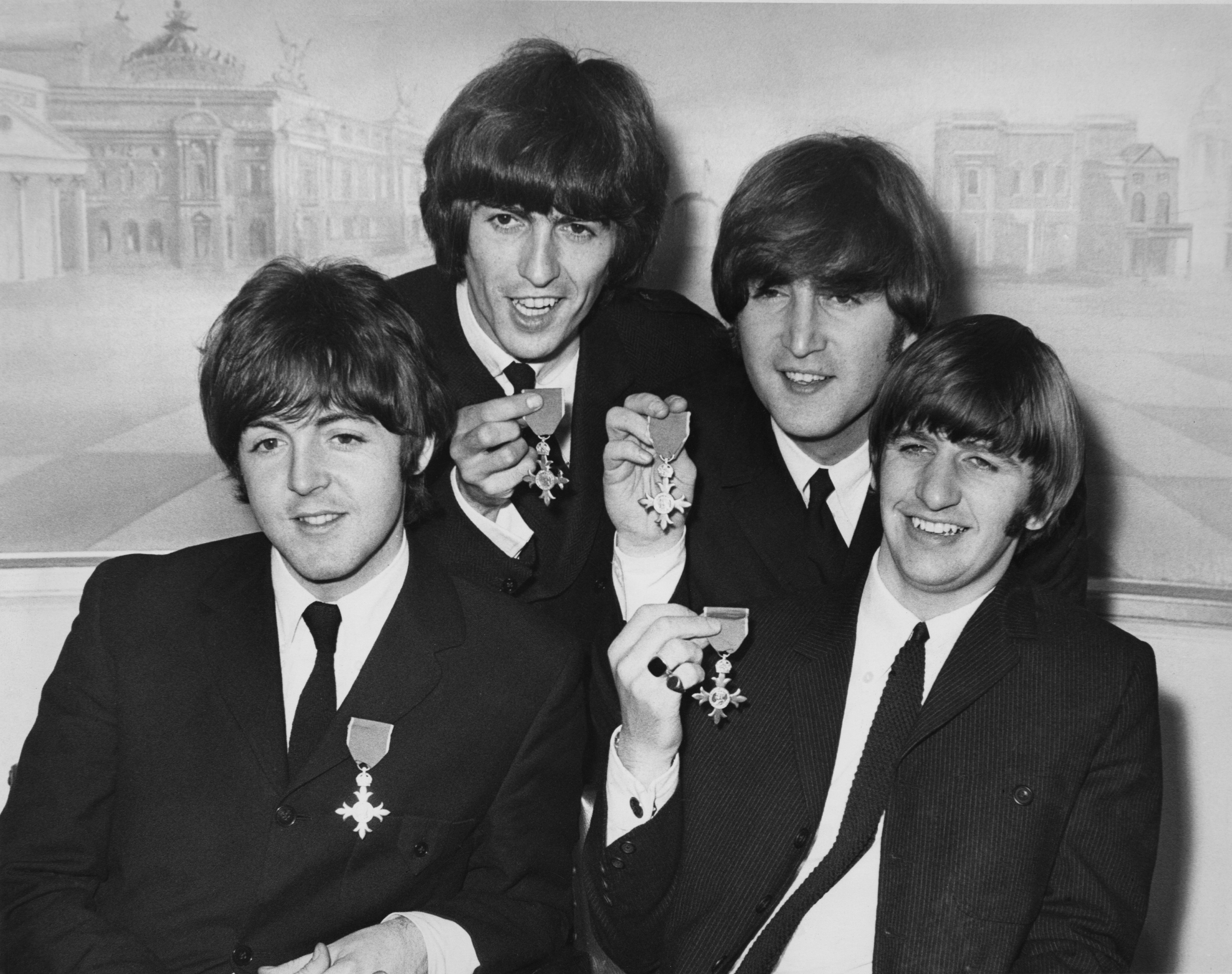 British rock group the Beatles hold a press reception at the Saville Theatre in London after each received an MBE at Buckingham Palace, 26th October 1965. From left to right, Paul McCartney, George Harrison, John Lennon, Ringo Starr. (Photo by Central Press/Hulton Archive/Getty Images)
