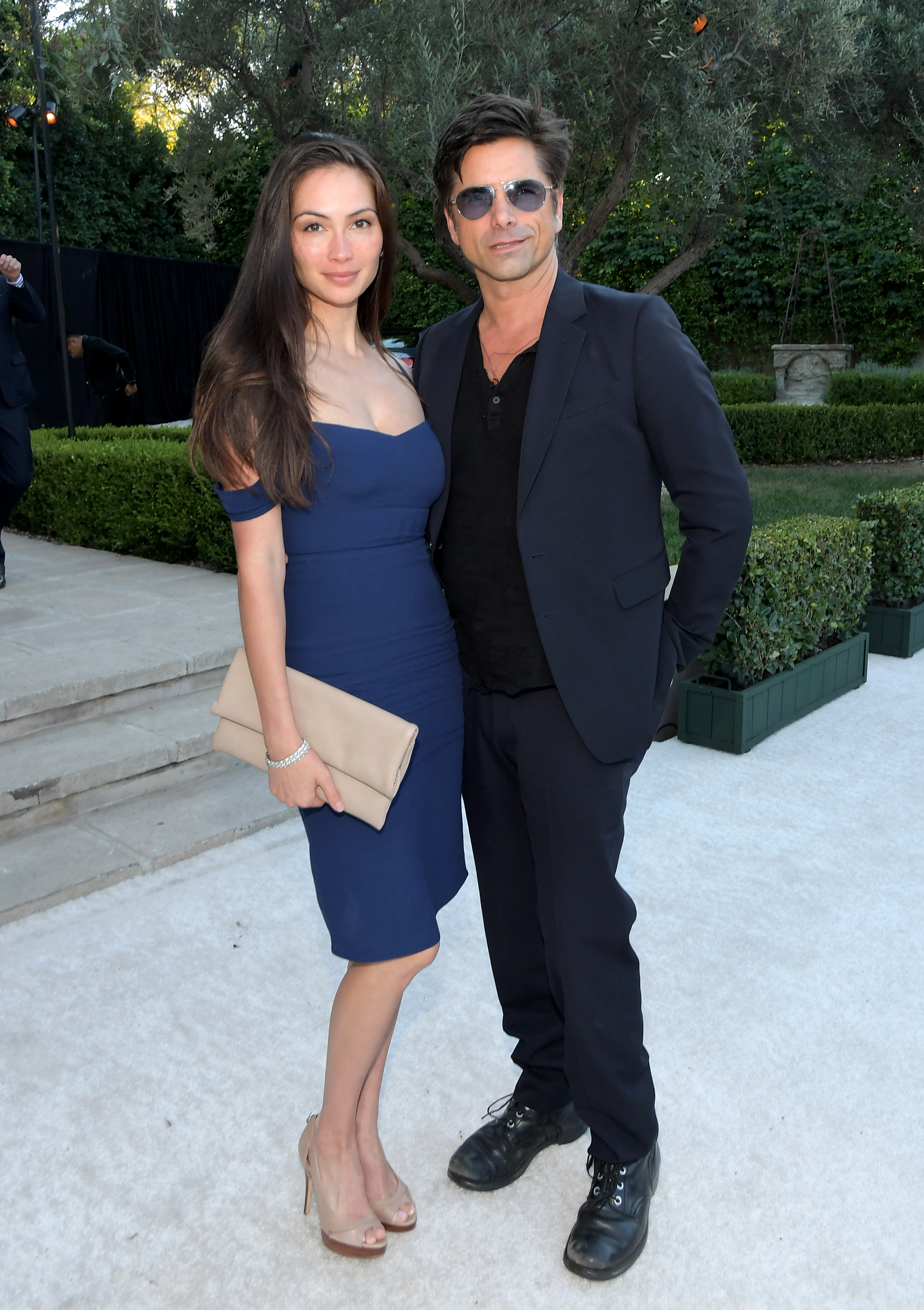 Caitlin McHugh and John Stamos attend Ted Sarandos' 2018 Annual Netflix Emmy Nominee Toast on September 15, 2018 in Los Angeles, California.