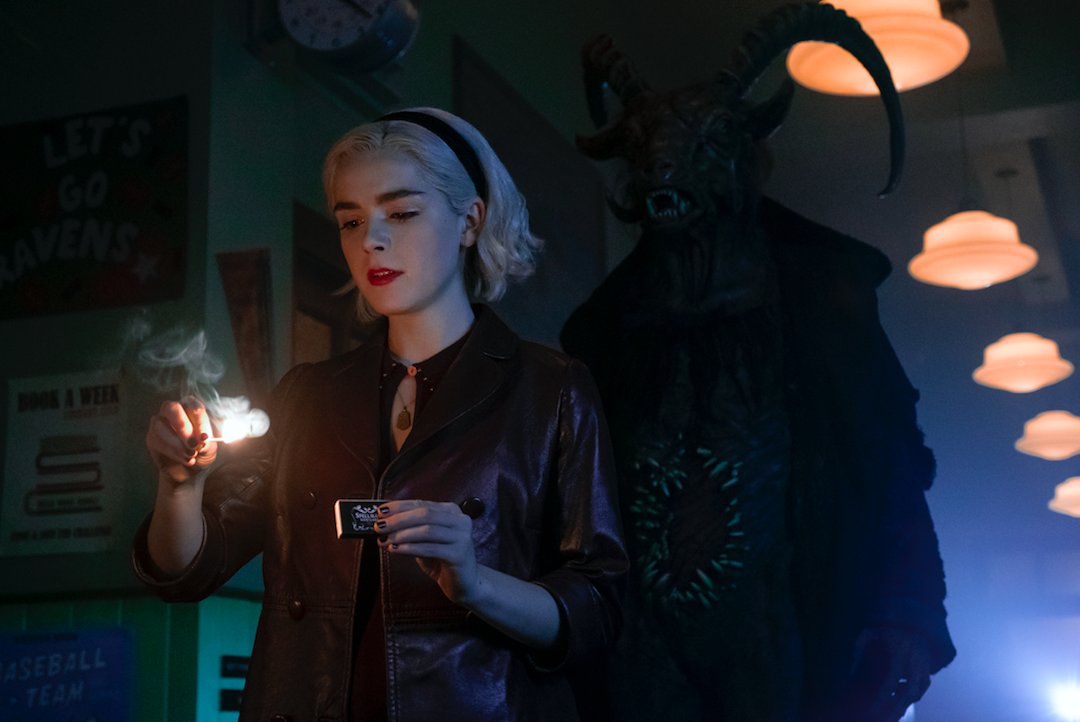 Sabrina on the verge of burning down Baxter High with Satan behind her (Netflix)