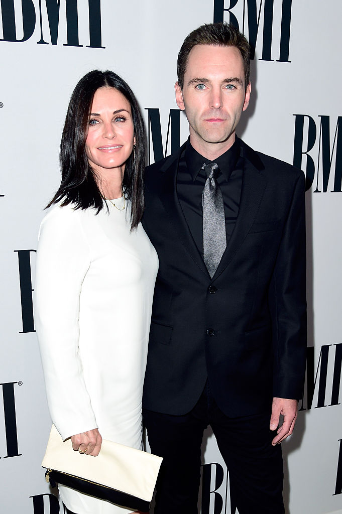 Actress Courteney Cox and musician Johnny McDaid of Snow Patrol attend The 64th Annual BMI Pop Awards at the Beverly Wilshire Four Seasons Hotel on May 10, 2016, in Beverly Hills, California. (Photo by Frazer Harrison/Getty Images for BMI)