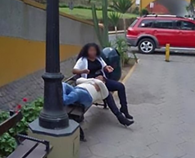 The photos, taken by the Google car in 2013, a familiar figure shows the woman stroking the hair of a man lying with his head in her lap. (Google Maps)