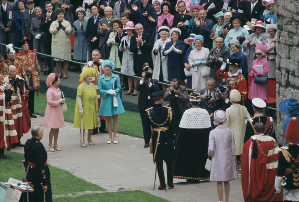 Prince Charles, Queen Elizabeth II and Prince Philip pose for photographers after the ceremony of Charles' investiture as Prince of Wales at Caernarfon Castle, Gwynedd, Wales, 1st July 1969. On the left are Princess Margaret, the Queen Mother, and Princess Anne. (Photo by Fox Photos/Hulton Archive/Getty Images