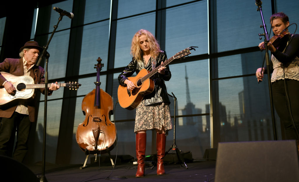 Buddy Miller (L) and Patty Griffin perform onstage for Emmylou Harris' exhibition debut at Country Music Hall of Fame and Museum on October 2, 2018, in Nashville, Tennessee. (Photo by Jason Kempin/Getty Images)