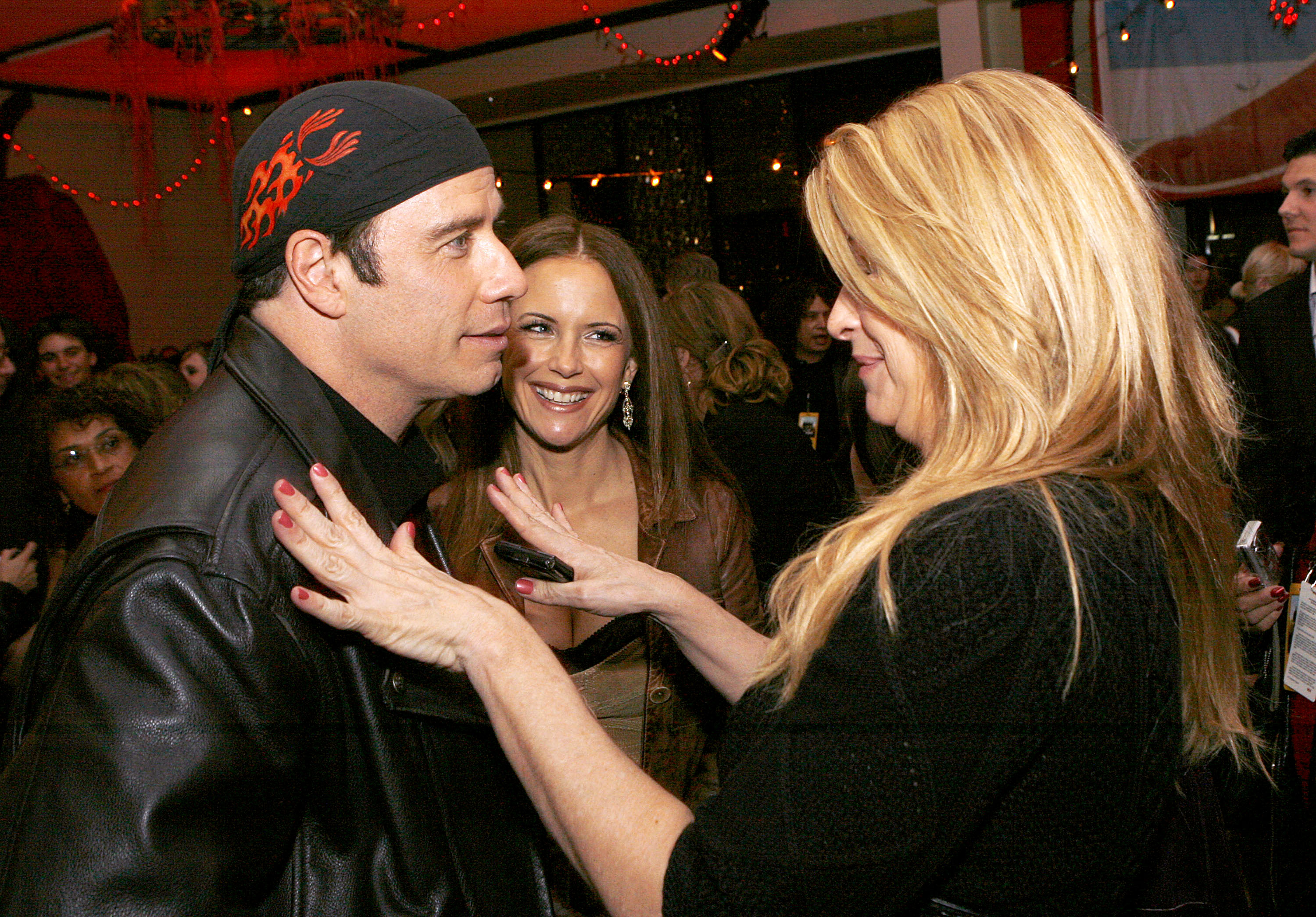 Actors John Travolta, Kelly Preston and Kirstie Alley talk at the afterparty for the premiere of Touchstone Picture's 'Wild Hogs' at the Annex on February 27, 2007, in Los Angeles, California. (Getty)