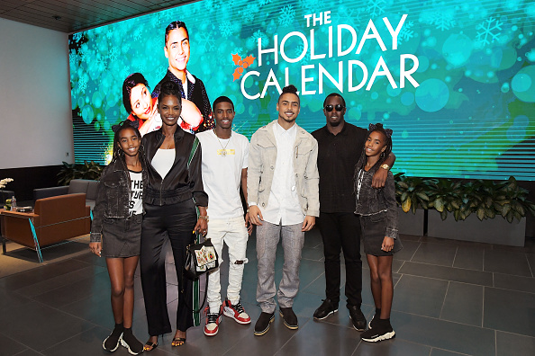 Kim Porter, Christian Casey Combs, Quincy Brown, Sean 'Diddy' Combs, D'Lila Star Combs, and Jessie James Combs attend 'The Holiday Calendar'. (Getty Images)