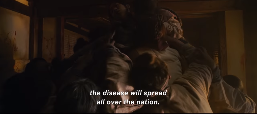 Zombies forming a mountain around a woman and eating her alive in the trailer of Netflix's Kingdom. Source: Youtube