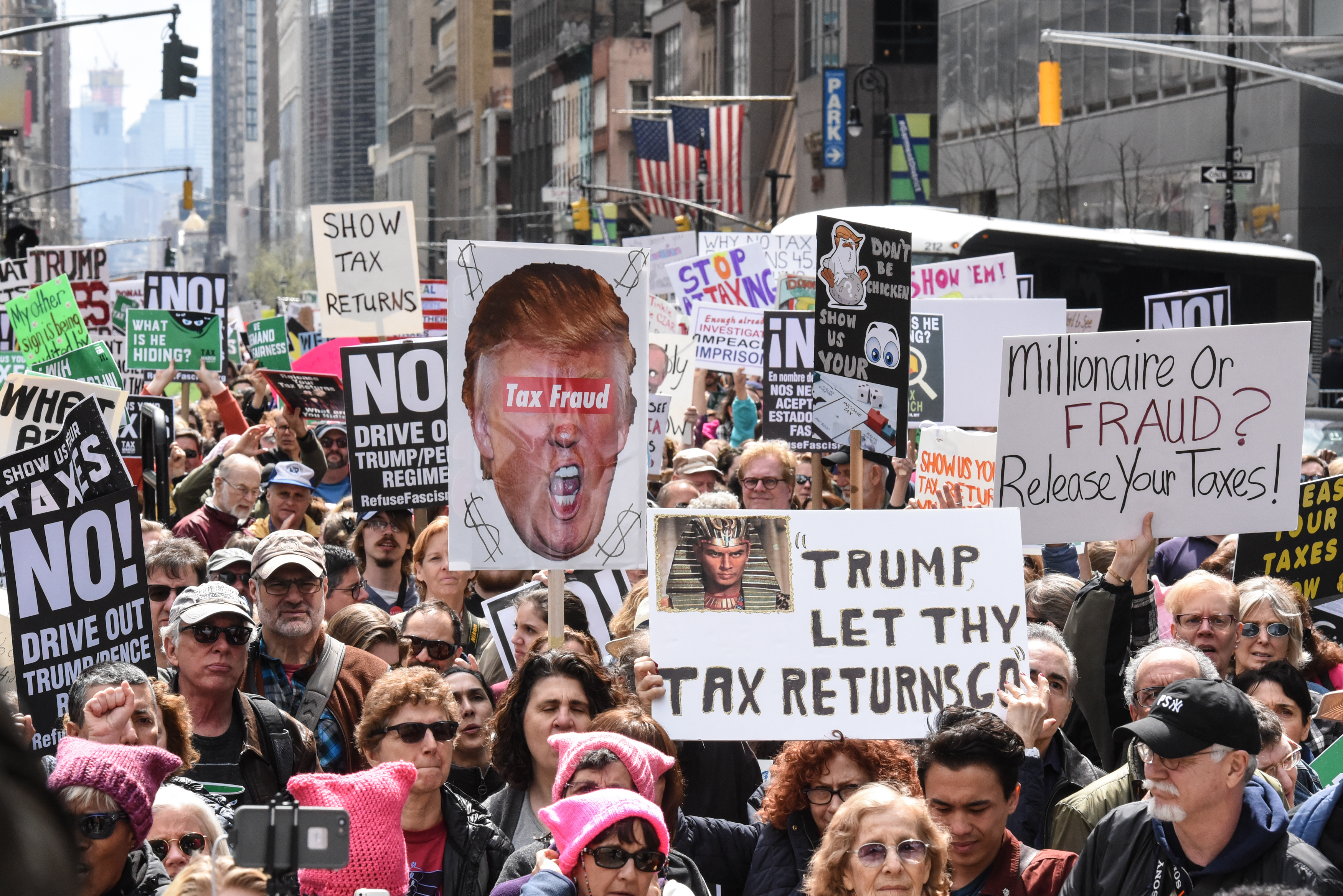People participate in a Tax Day protest on April 15, 2017 in New York City. Activists in cities across the nation are marching today to call on President Donald Trump to release his tax returns. (Getty Images)