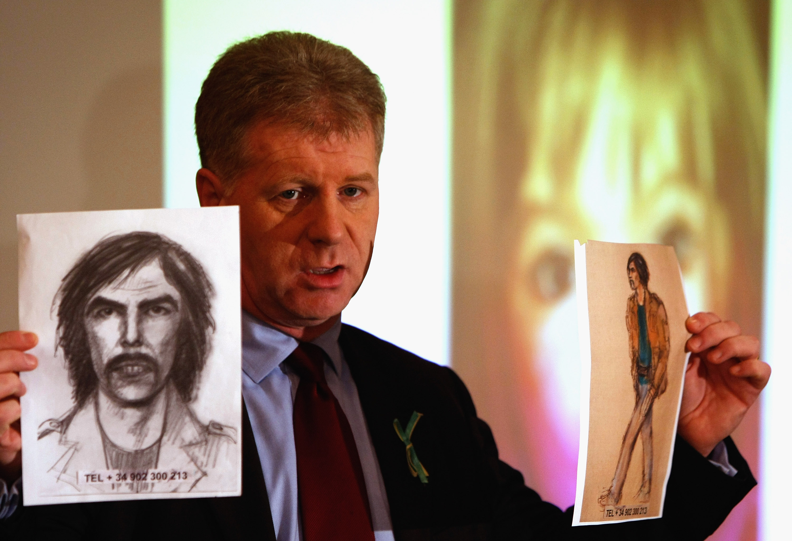 McCann family spokesman Clarence Mitchell holds two artist's impression of the new suspect on January 20, 2008, in London, England. The description has come from British woman Gail Cooper, who was staying with her family close to the McCann's apartment in Portugal. (Getty Images)